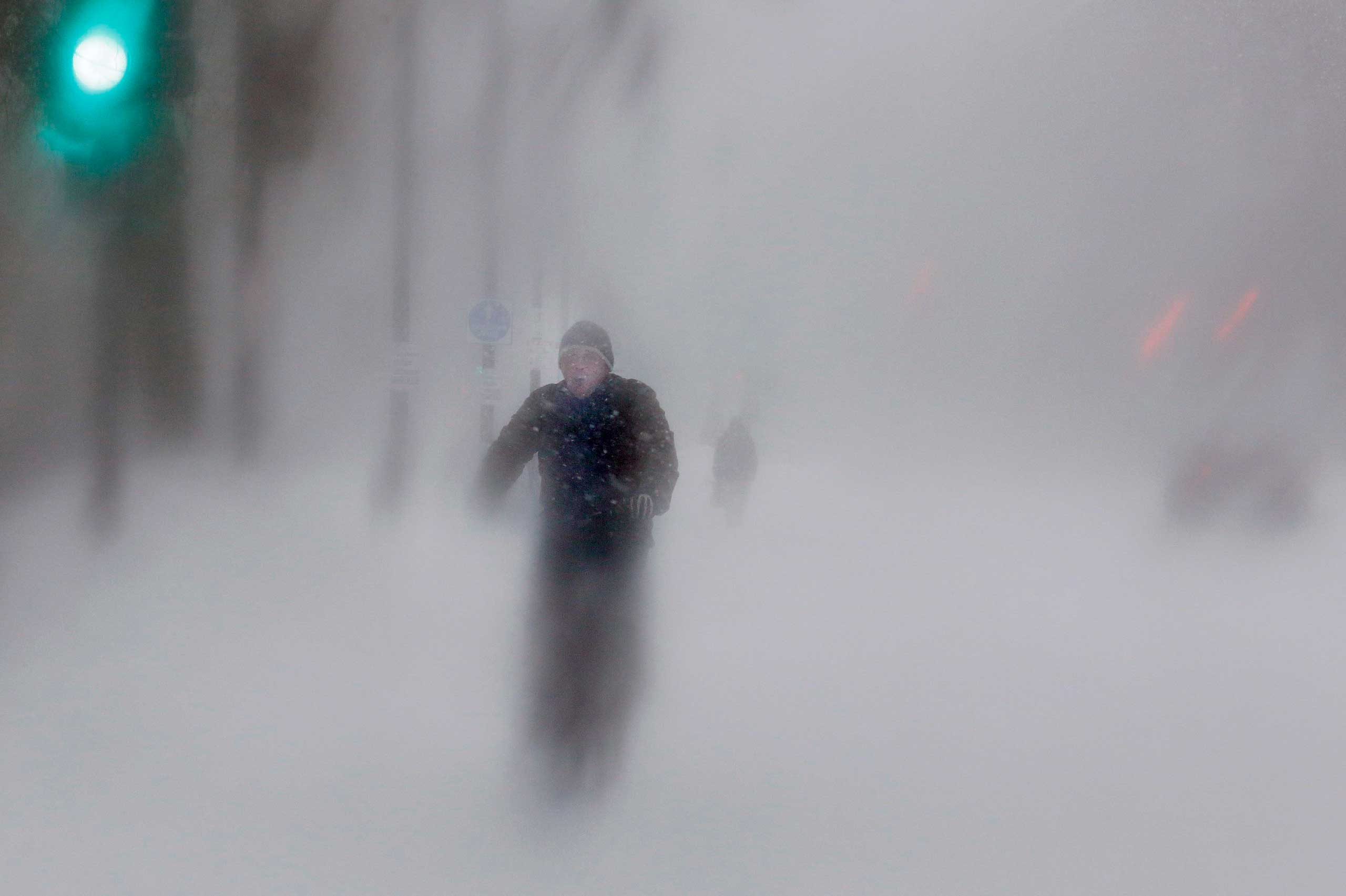 Jan. 27, 2015. A man rides his bike up Beacon Street during a blizzard in Boston, Mass. A blizzard swept across the northeastern U.S., dropping more than a foot of snow across Massachusetts and Connecticut.