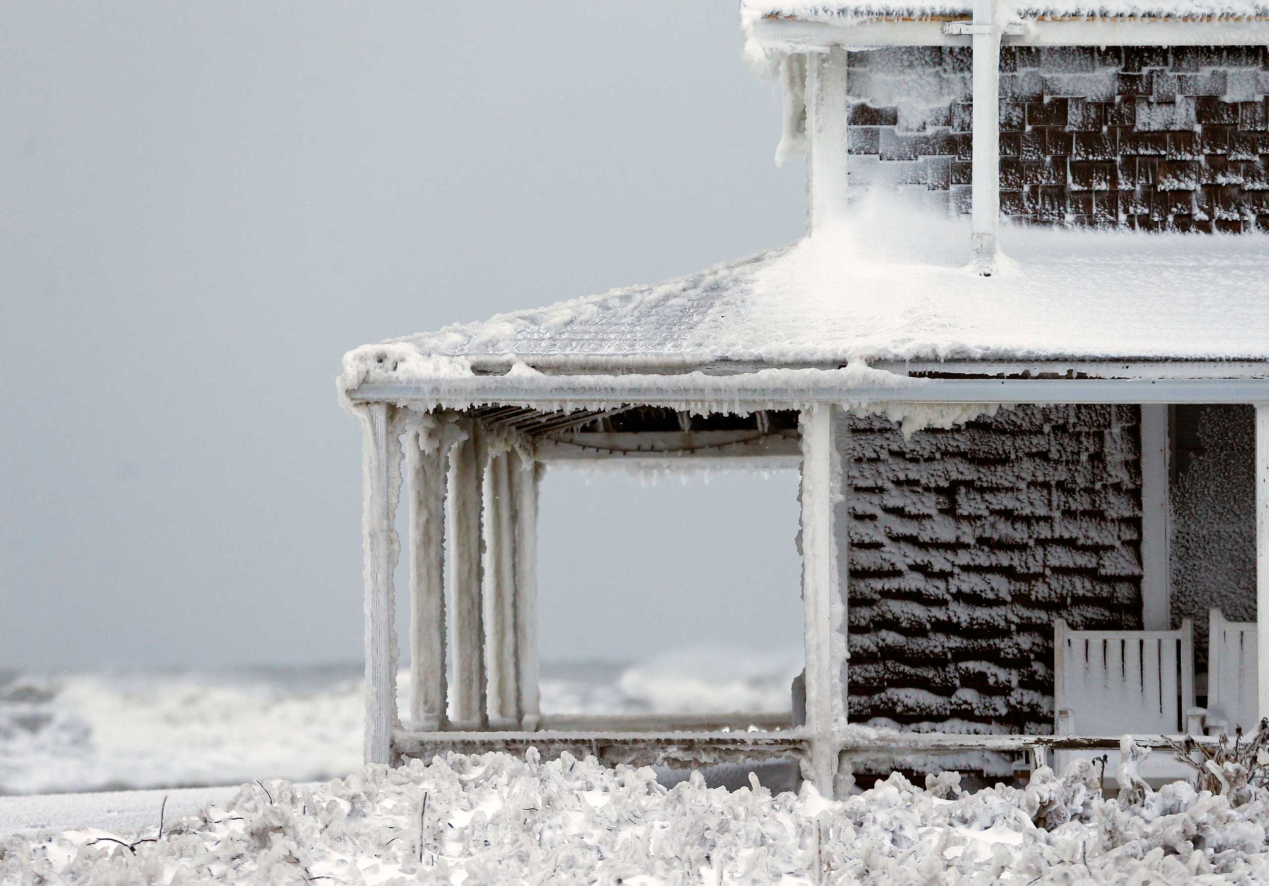 Jan. 28, 2015. Frozen sea spray coats a house the day after a winter storm in Scituate, Mass.