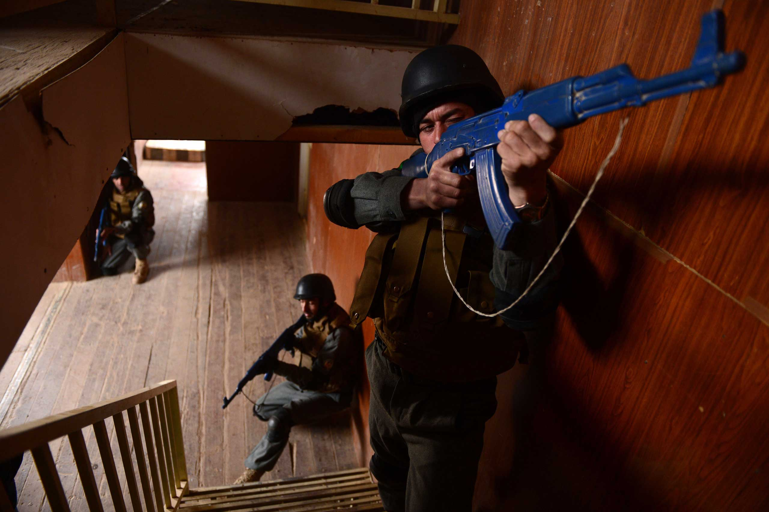 Jan. 27, 2015. Afghan policemen perform a drill during exercises at a police training centre in Herat. An estimated 17,000 foreign soldiers will stay on to assist the local police and army, who face a major challenge as the international military presence declines.