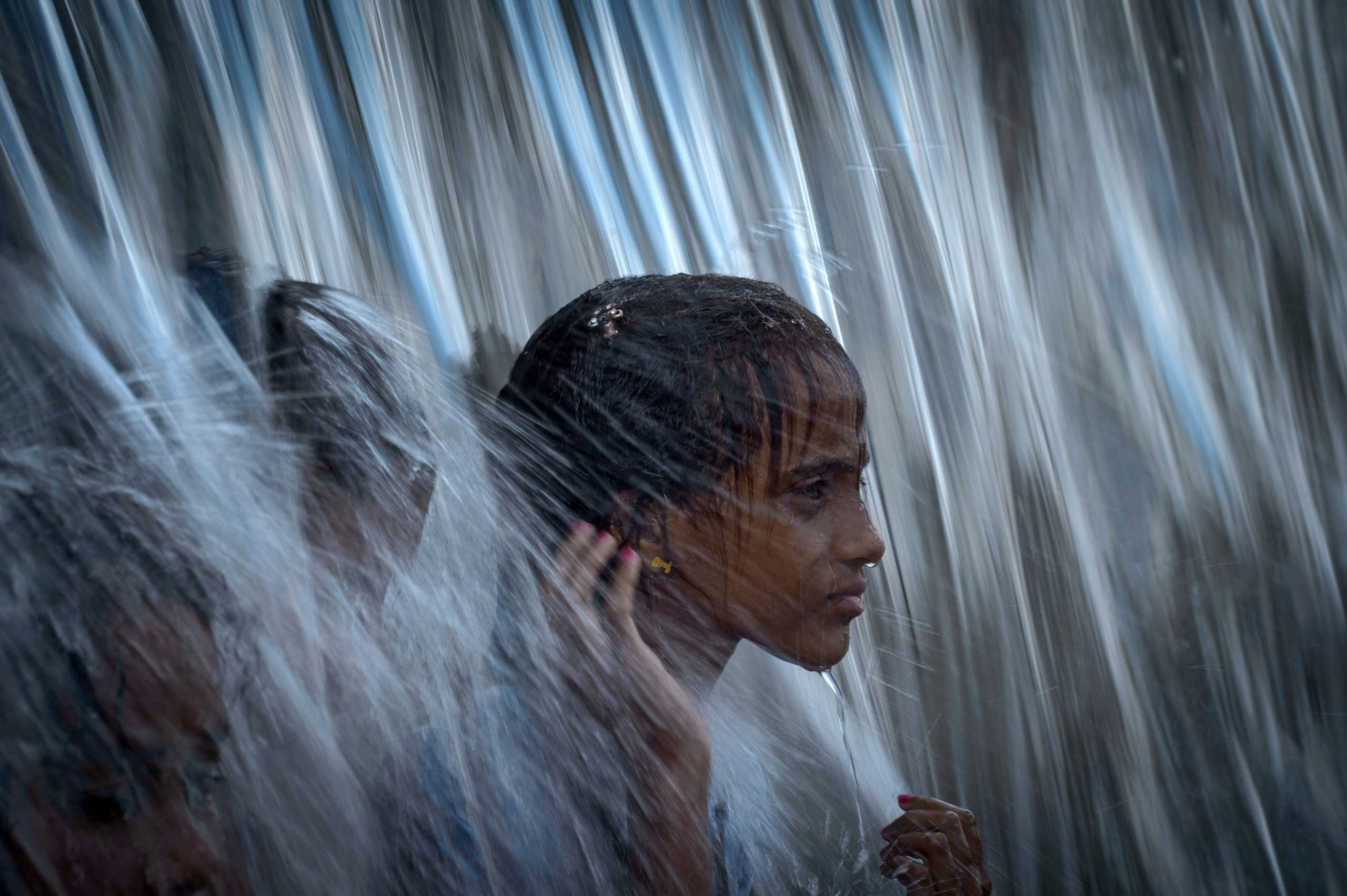 Jan. 25, 2015. A girl plays with a curtain of water at Madureira park in Rio de Janeiro, Brazil.