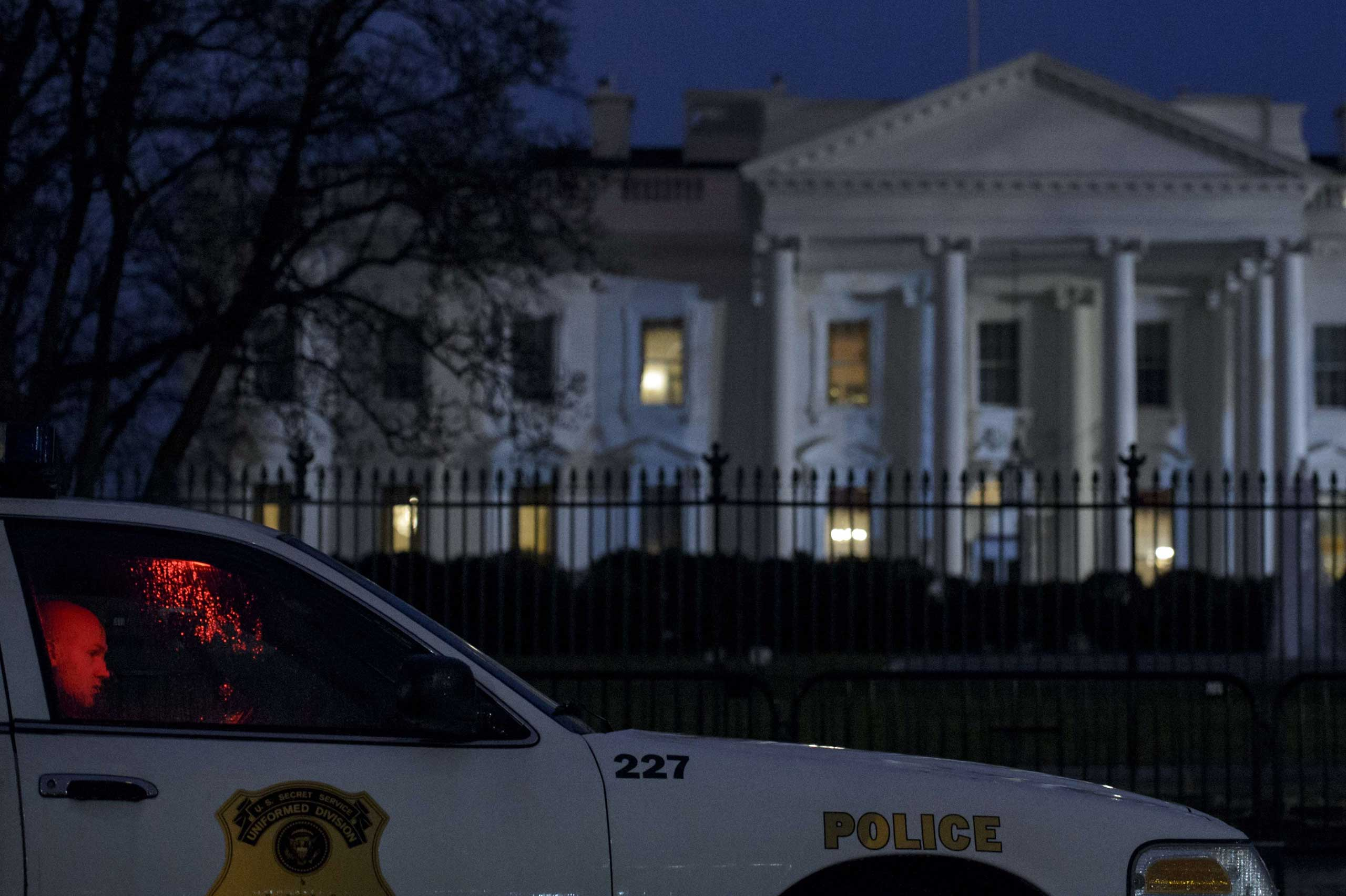 Jan. 26, 2015. A member of the Secret Service's Uniformed Division sits in his car on Pennsylvania Avenue outside the White House in Washington, D.C. A small aerial drone was found on the grounds of the White House but poses no threat.