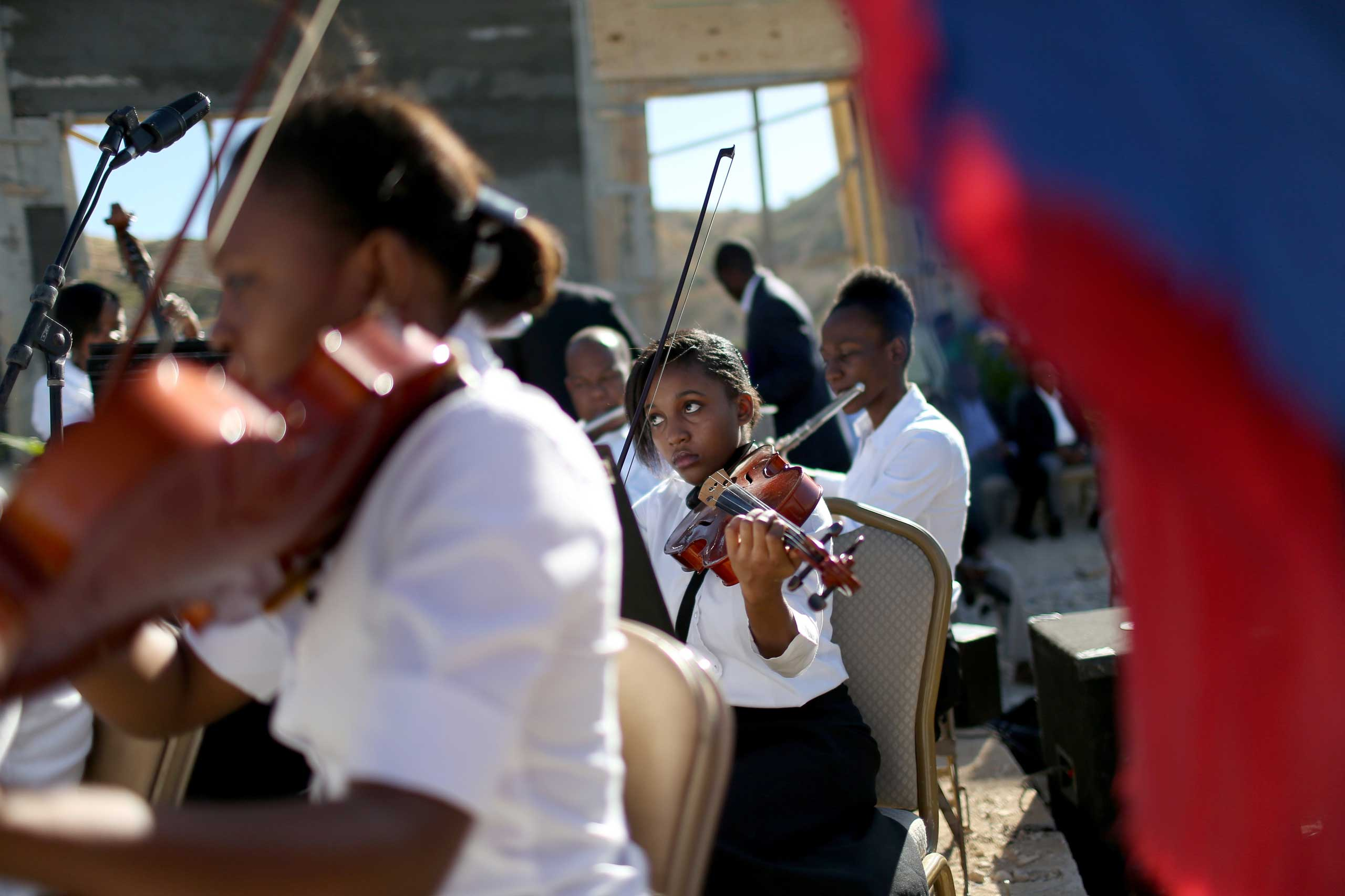 Jan. 12, 2015. Musicians play during a ceremony to remember those killed and buried in the mass grave in Titanyen, Haiti, during a service for the 5-year anniversary of a magnitude 7.0 earthquake that killed                                316,000 people.