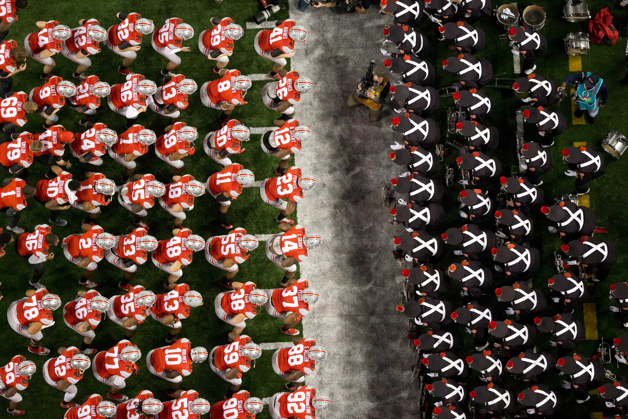 Jan. 12, 2015. The Ohio State Buckeyes football team squares off against the Ohio State University Marching Band, pre-game, National Championship game at the Cowboys Stadium, Arlington, TX.