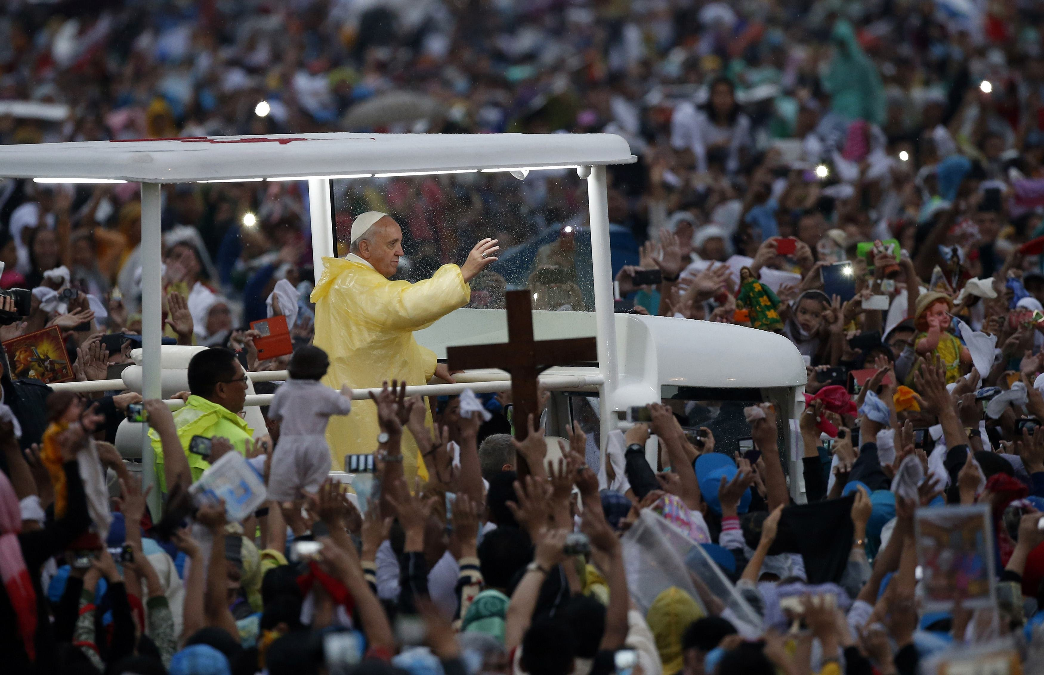 Pope Francis waves from the popemobile after leading a Mass at Rizal Park in Manila on Jan. 18, 2015.