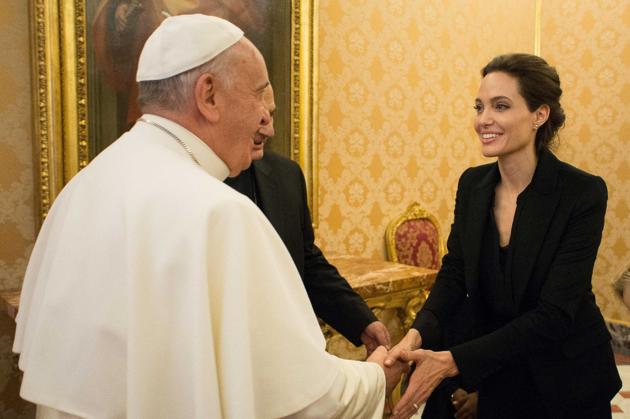 Pope Francis meeting with US actress and UNHCR ambassador Angelina Jolie at the Vatican, Jan. 8, 2015.