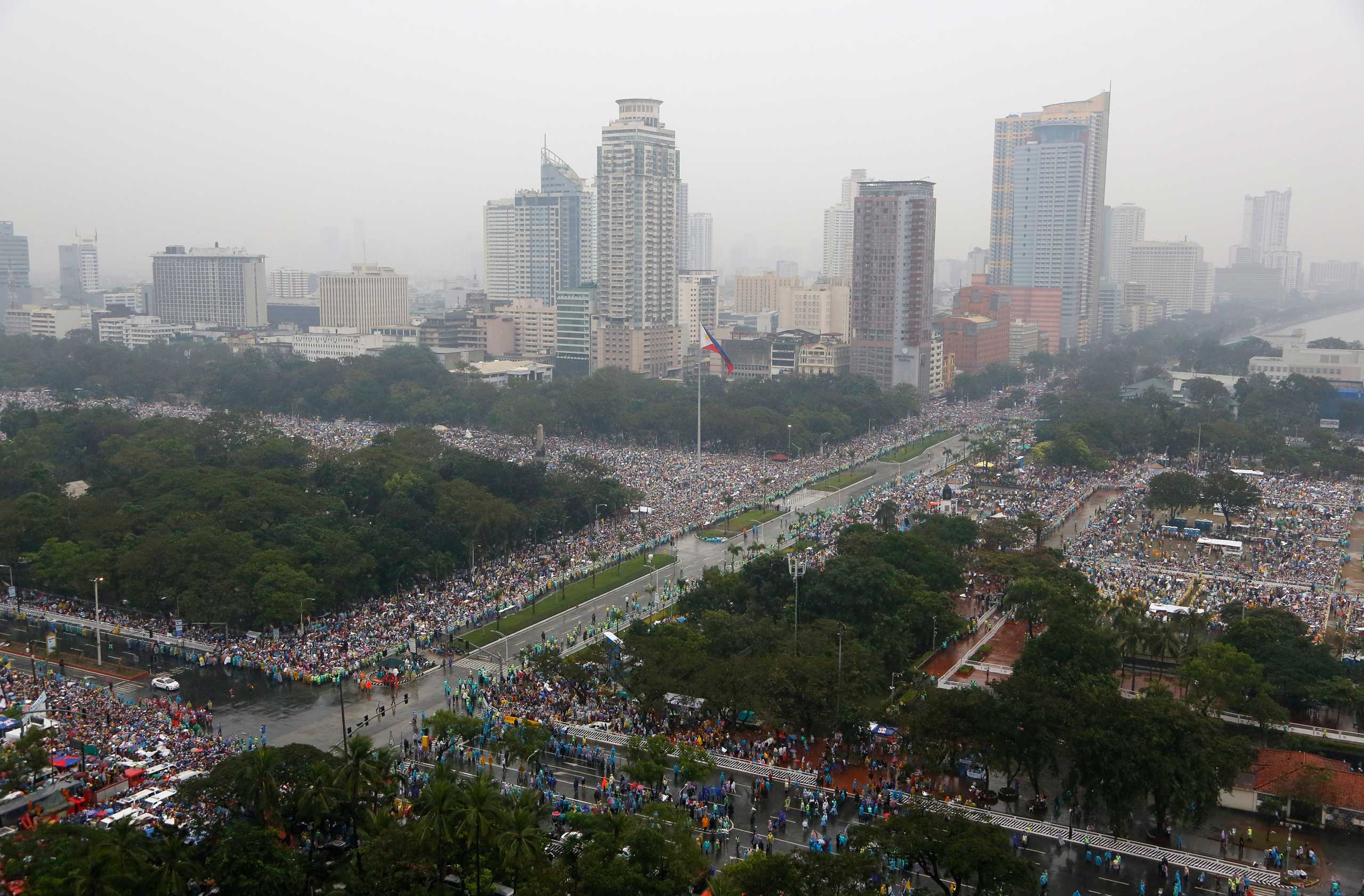 Millions of the faithful are seen in the Rizal Park area where Pope Francis celebrates Mass in Manila, Jan. 18, 2015.