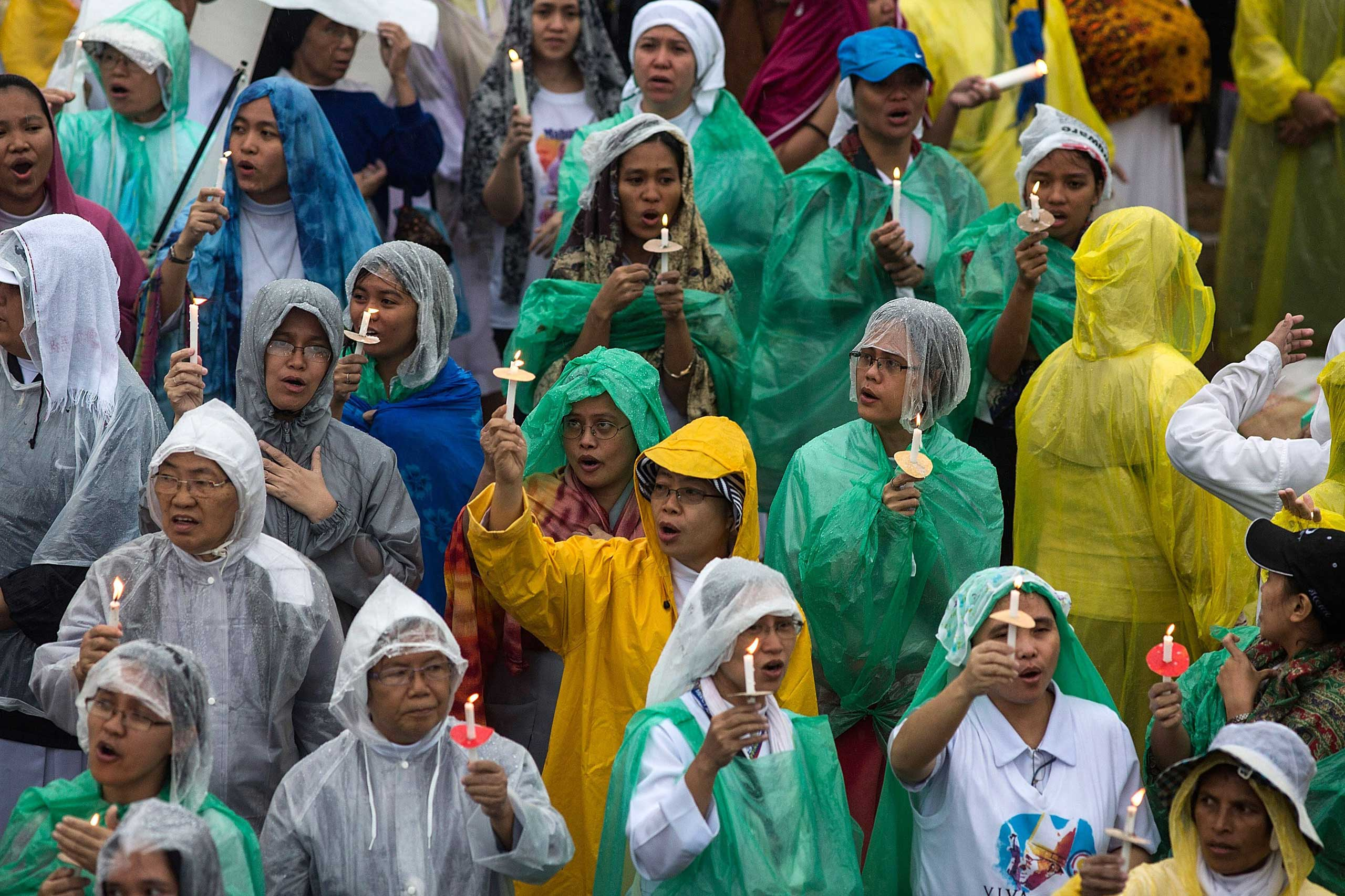 Pilgrims pray as Pope Francis conducts mass at the Rizal Park on Jan. 18, 2015 in Manila.
