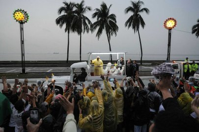Pope Francis waves from the popemobile after leading a Mass at Rizal Park in Manila, Jan. 18, 2015.