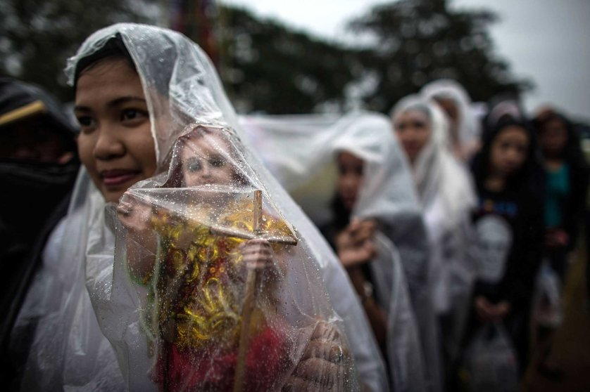 Pilgrims wait for Pope Francis conducts mass at the Rizal Park on Jan. 18, 2015 in Manila.