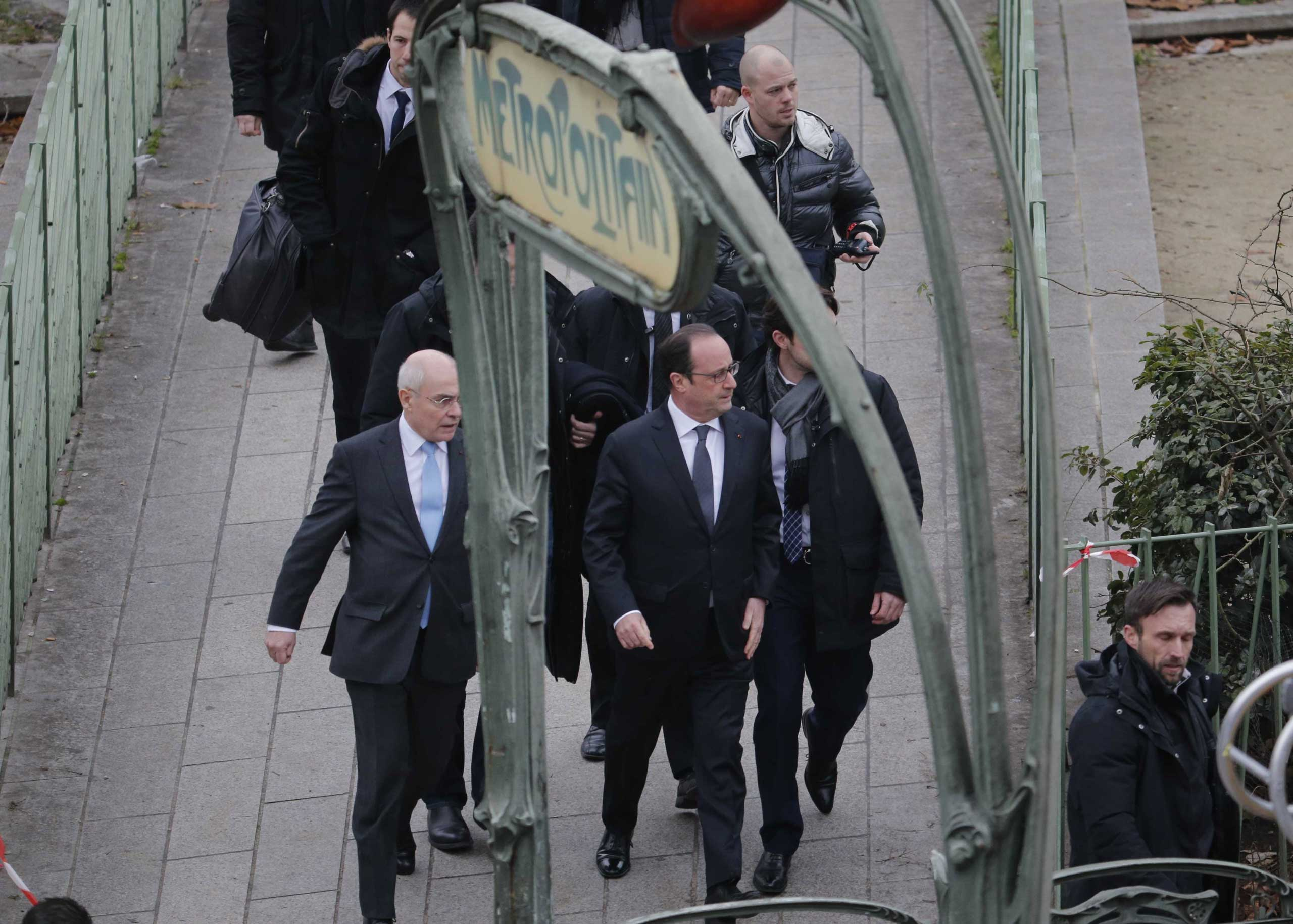 President Francois Hollande arrives after a shooting at the Paris offices of Charlie Hebdo, a satirical newspaper, Jan. 7, 2015.