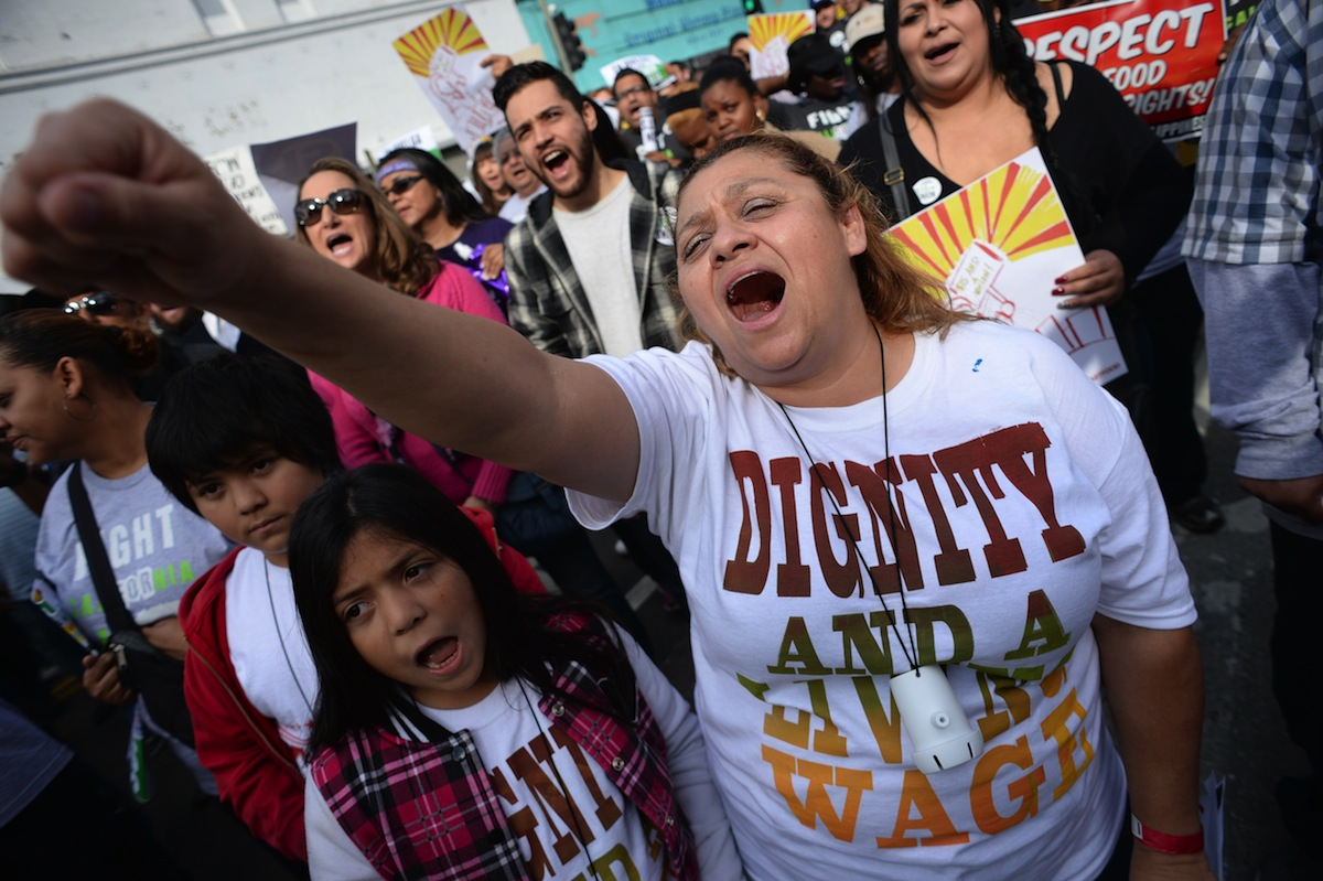 Fast food workers, healthcare workers and their supporters march to demand an increase of the minimum wage, in Los Angeles on Dec. 4, 2014