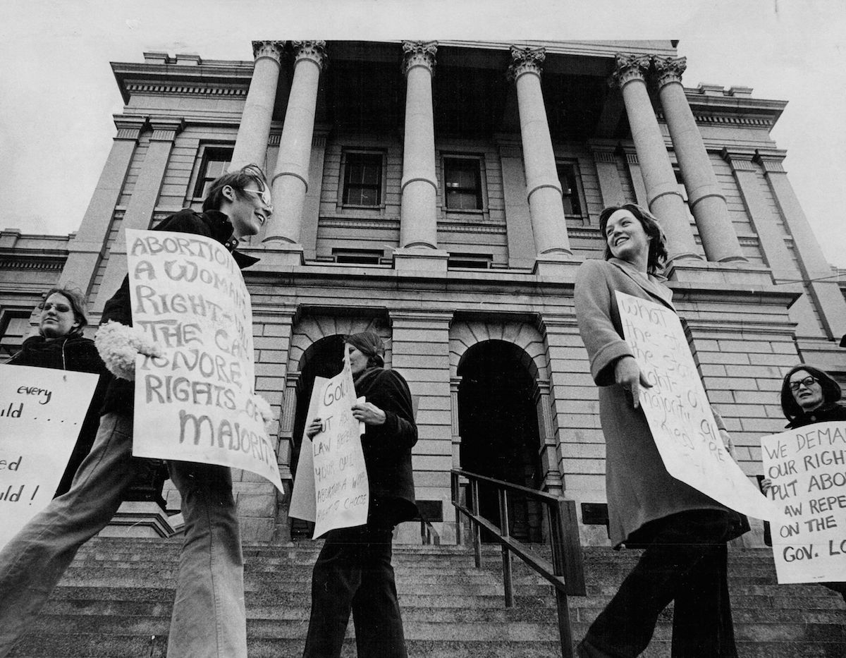 Members of the Mountain States Women's Abortion Coalition form a picket line in front of the State Capitol in January of 1972