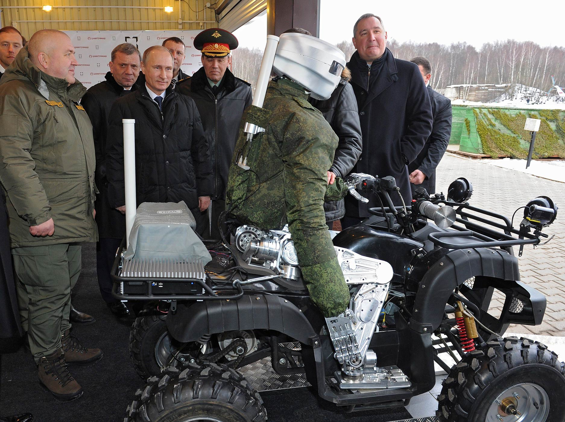 Russian President Vladimir Putin examines a Russian made android robot during his visits to the Central Scientific Research Institute of Precise Mechanical Engineering in Klimovsk, Russia on Jan. 20, 2015.