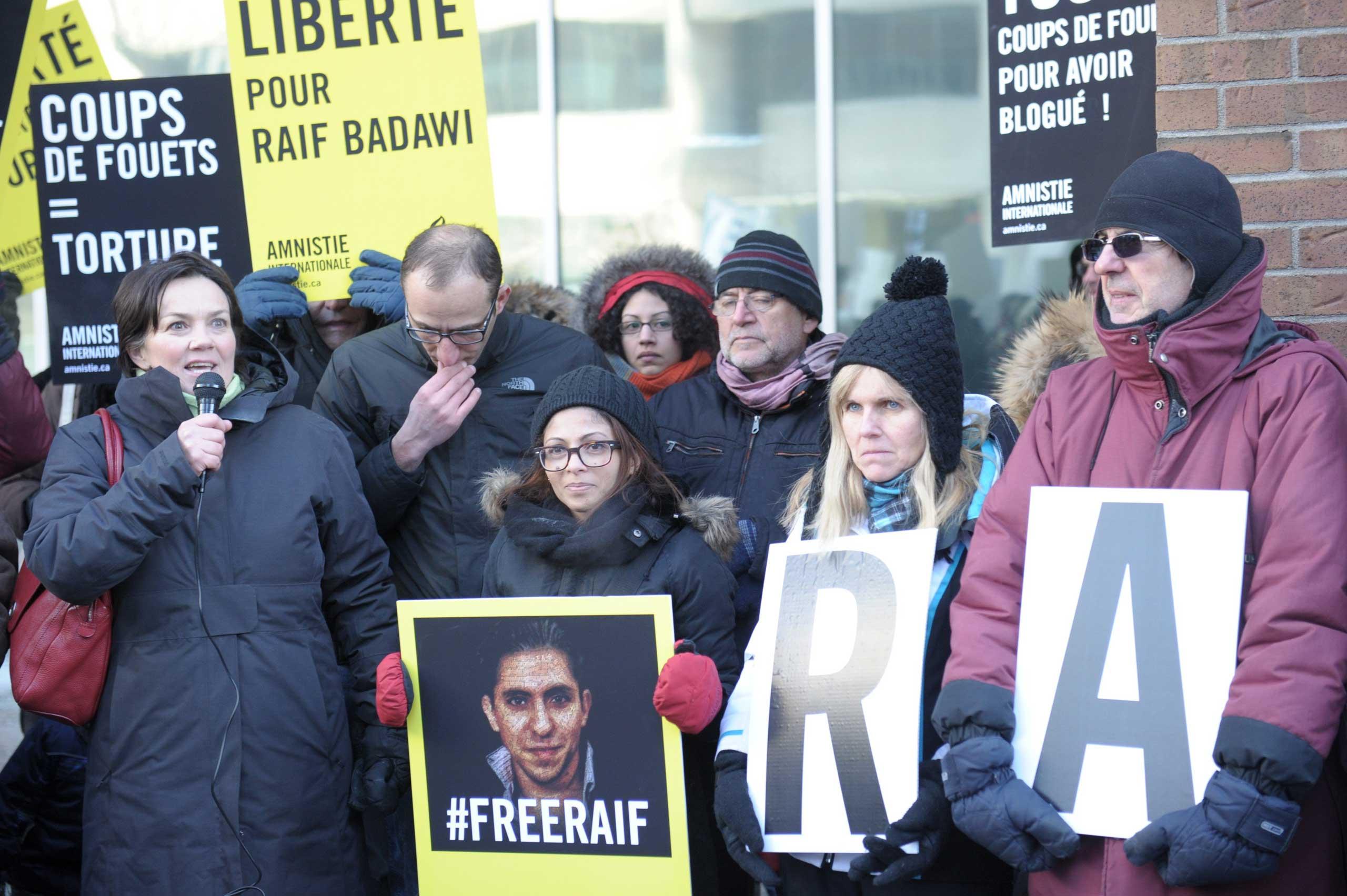 Ensaf Haidar (C), the wife of the Saudi Blogger Raif Badawi, holds a vigil urging Saudi Arabia to free her husband in Montreal on Jan. 13, 2015.