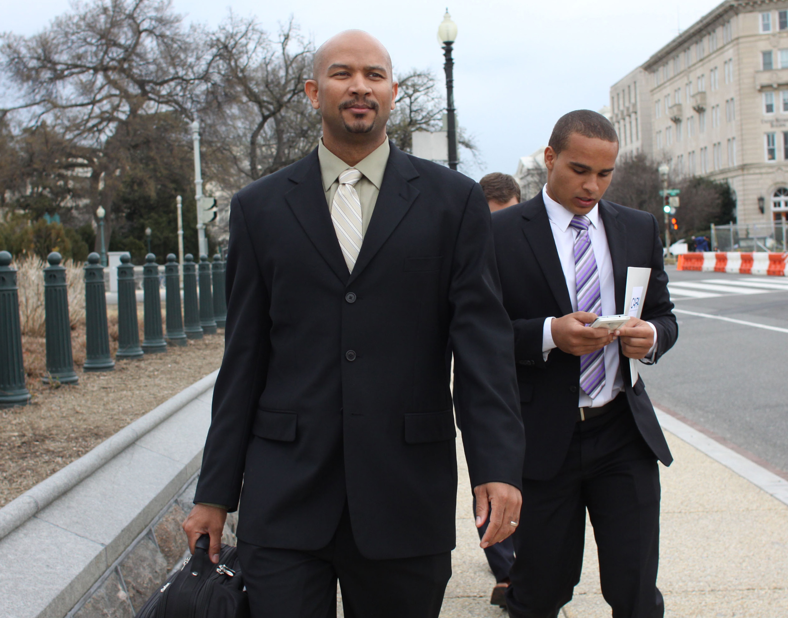Ramogi Huma (left), founder and president of the National College Players Association, arrive on Capitol Hill in Washington on April 2, 2014.