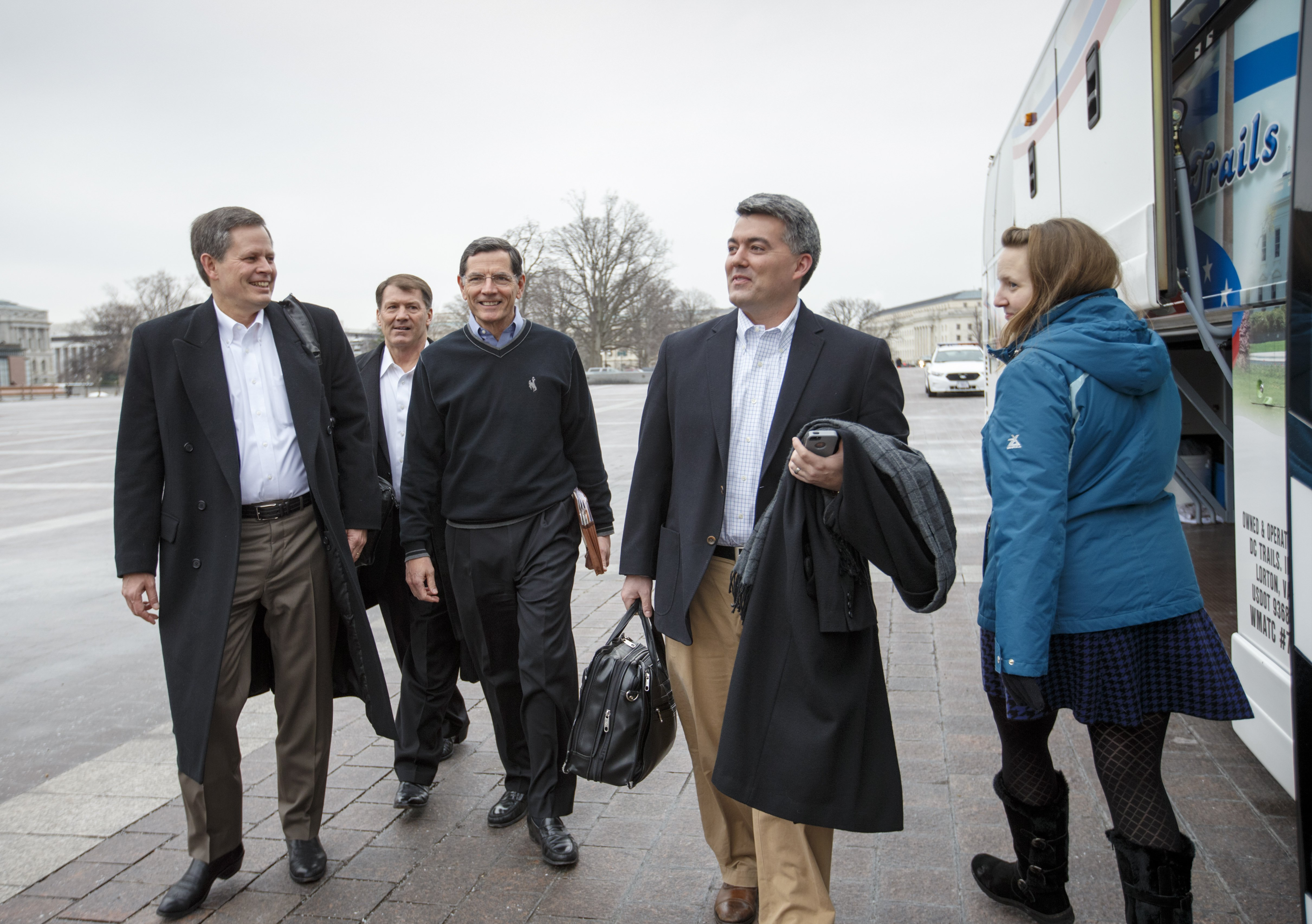 From left, Sen. Steve Daines, R-Mont., Sen. Mike Rounds, R-S.D., Sen. John Barrasso, R-Wyo., and Sen. Cory Gardner, R-Colo., prepare to board a tour bus to join Senate and House Republicans at a two-day policy retreat in Hershey, Pa. on Jan. 14, 2015 in Washington.