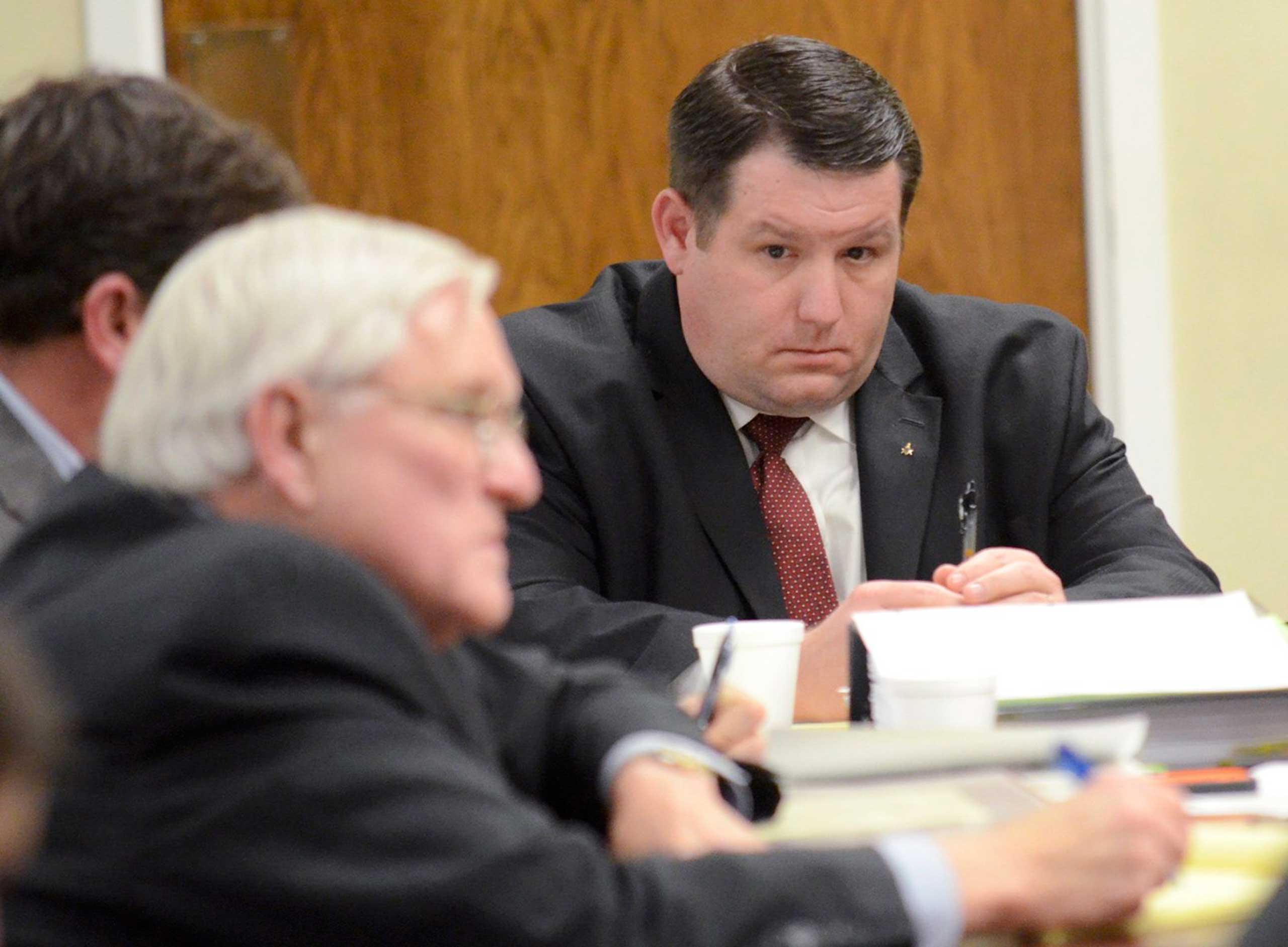 Former Eutawville Police Chief Richard Combs sits with lawyers on the second day of testimony in his trial for the murder of Bernard Bailey in Orangeburg, South Carolina, Jan. 8, 2015.