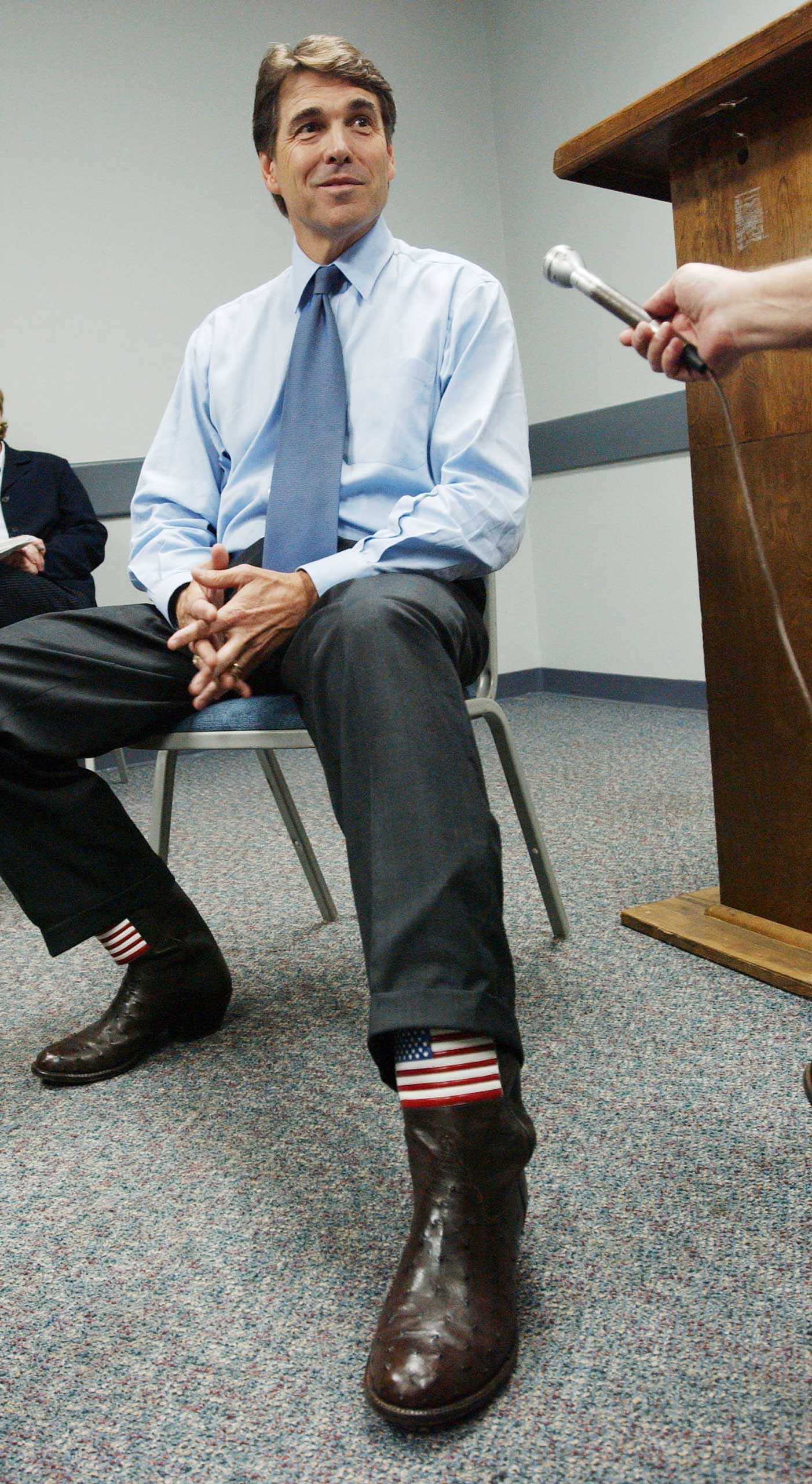 Like his predecessor, former Texas Gov. Rick Perry long favored cowboy boots, but he's no longer able to wear them.