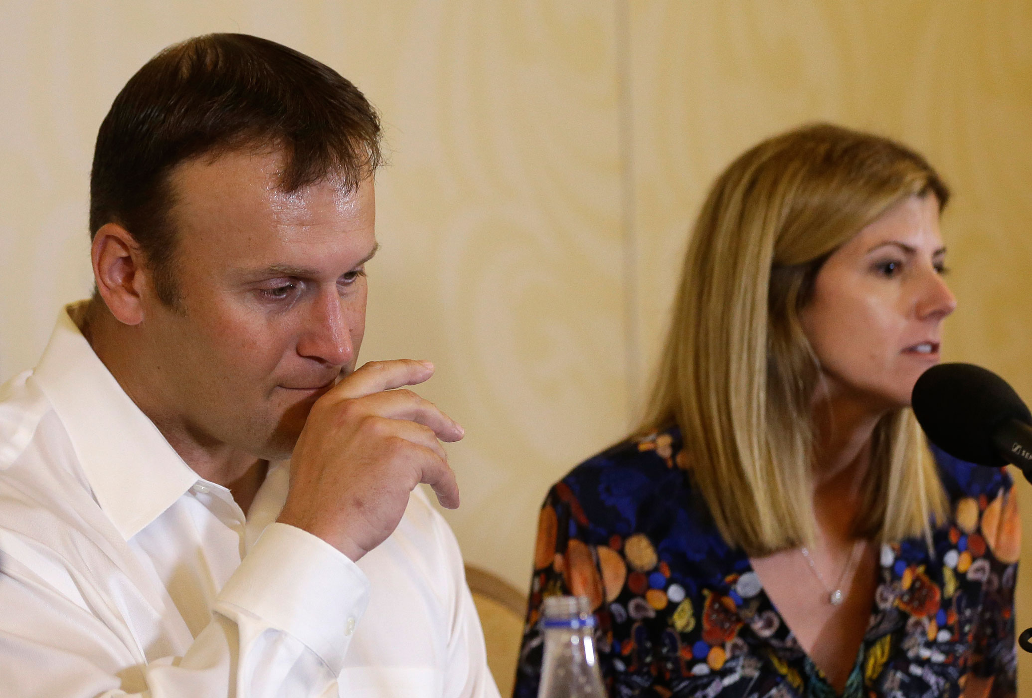 Former Miami Dolphins fullback Rob Konrad, left, listens while his wife Tammy, right, responds to a question during a news conference on Jan. 12, 2015, in Plantation, Fla.