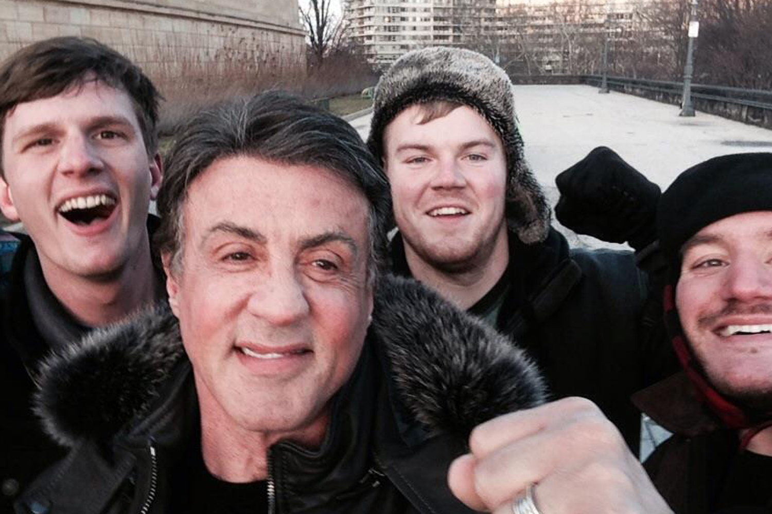In this Jan. 17, 2015, photo provided by Peter Rowe, Rowe, right, takes a selfie with friends Jacob Kerstan, left, Andrew Wright, third from left and actor Sylvester Stallone in Philadelphia.