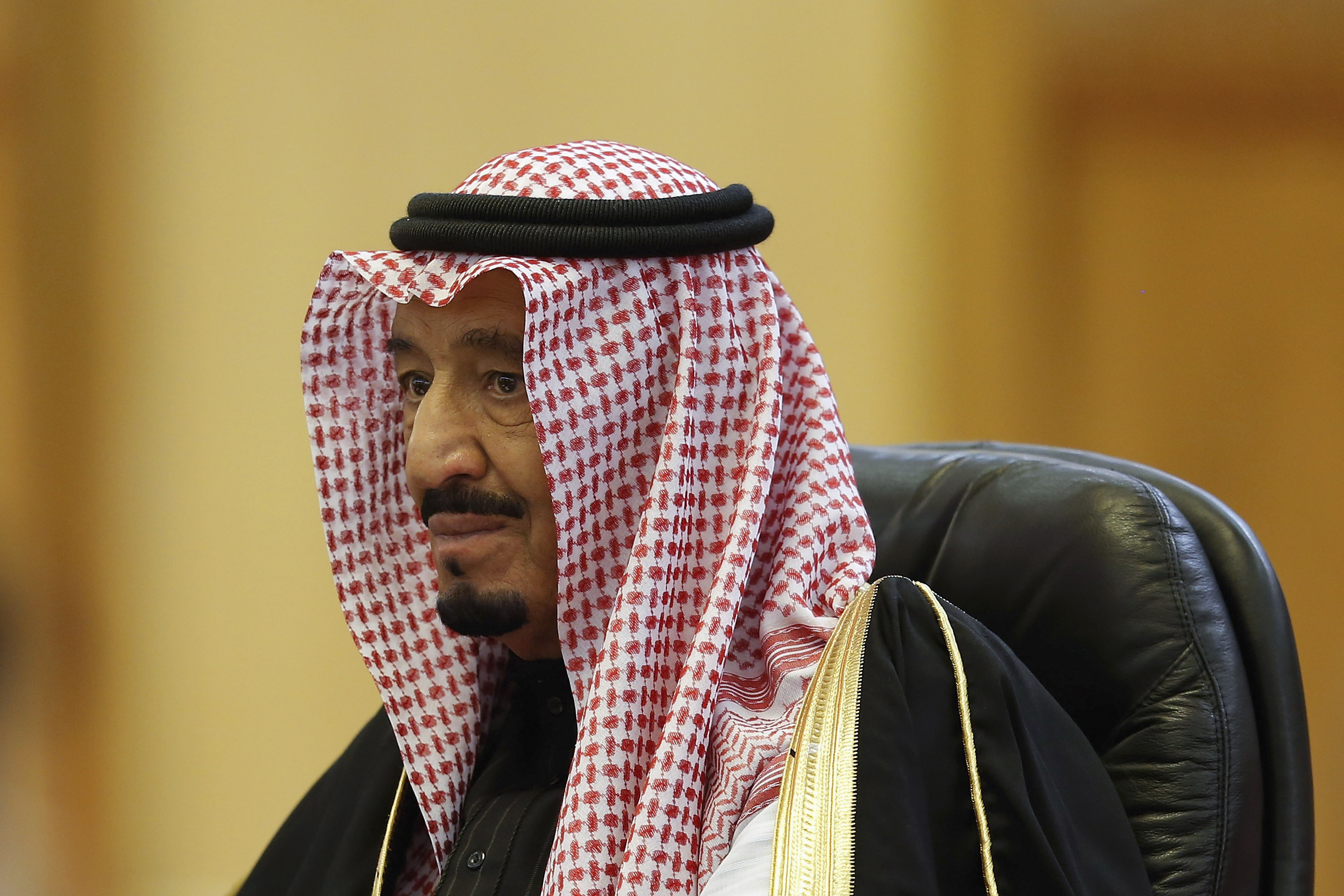 Saudi Arabia's King Salman looks on during a meeting at the Great Hall of the People in Beijing on March 13, 2014