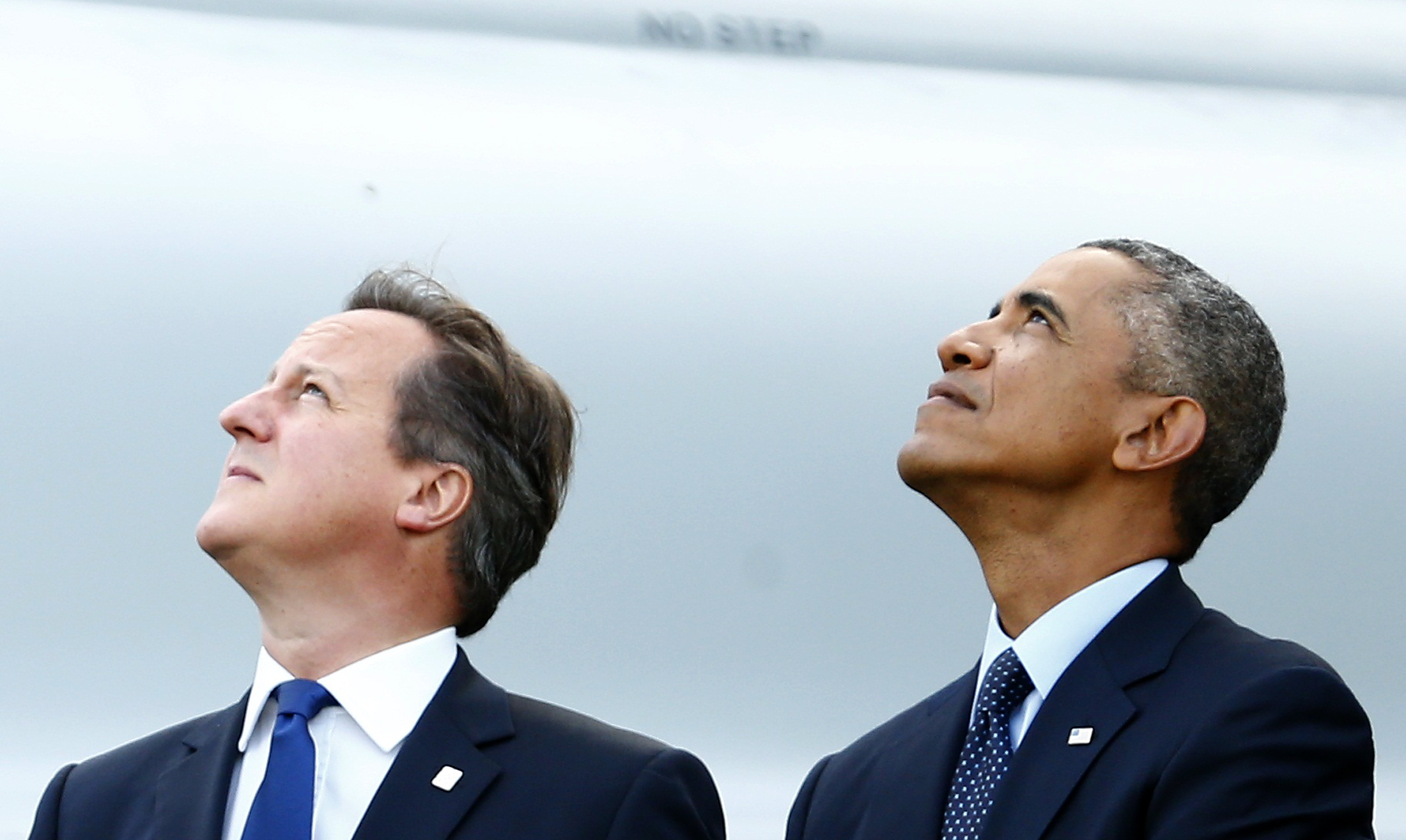 U.K. Prime Minister David Cameron, left, and U.S. President Barack Obama watch a flypast by the Red Arrows during the NATO summit in Wales on Sept. 5, 2014