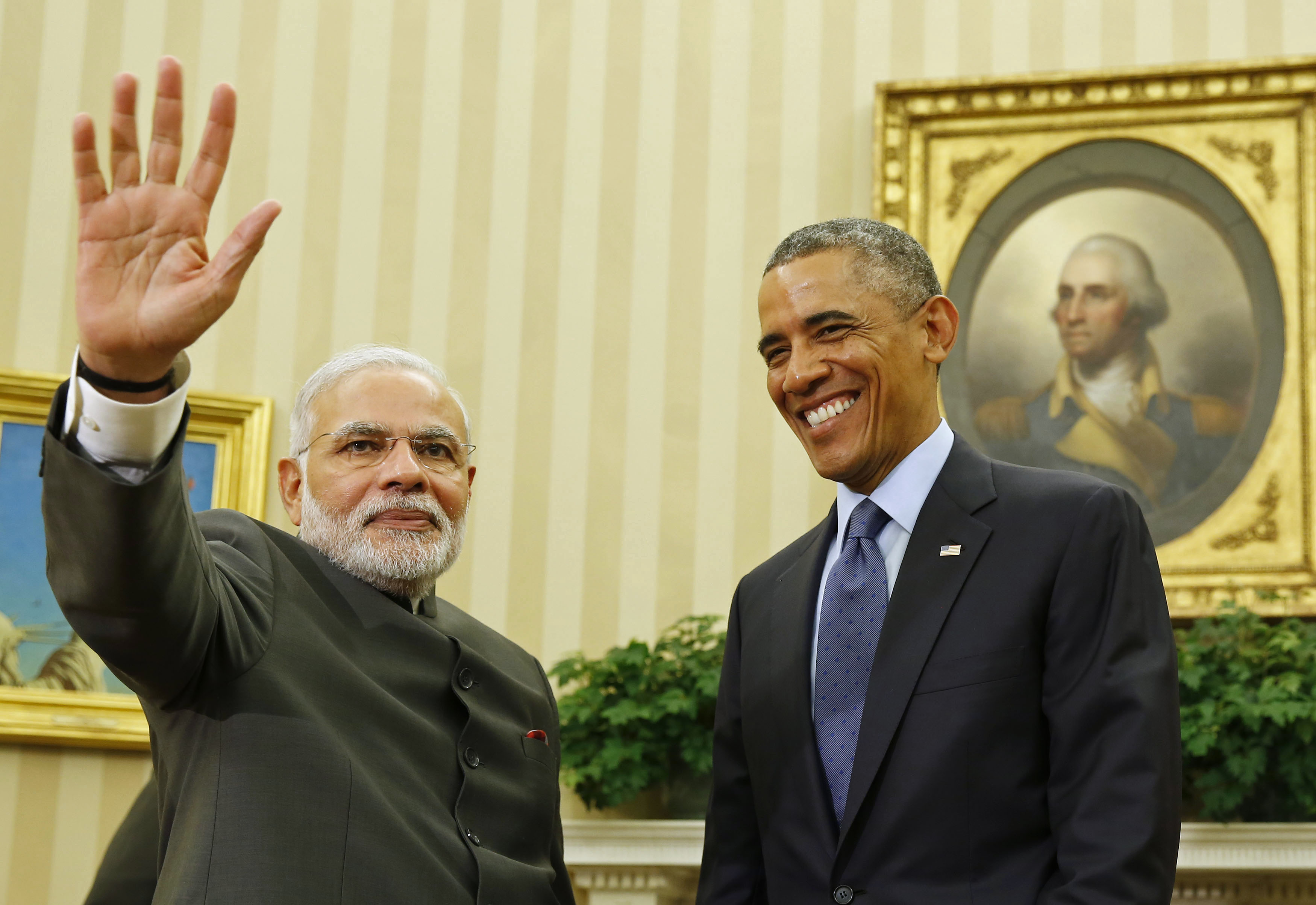 U.S. President Barack Obama smiles as he hosts a meeting with India's Prime Minister Narendra Modi in the Oval Office of the White House in Washington September 30, 2014.