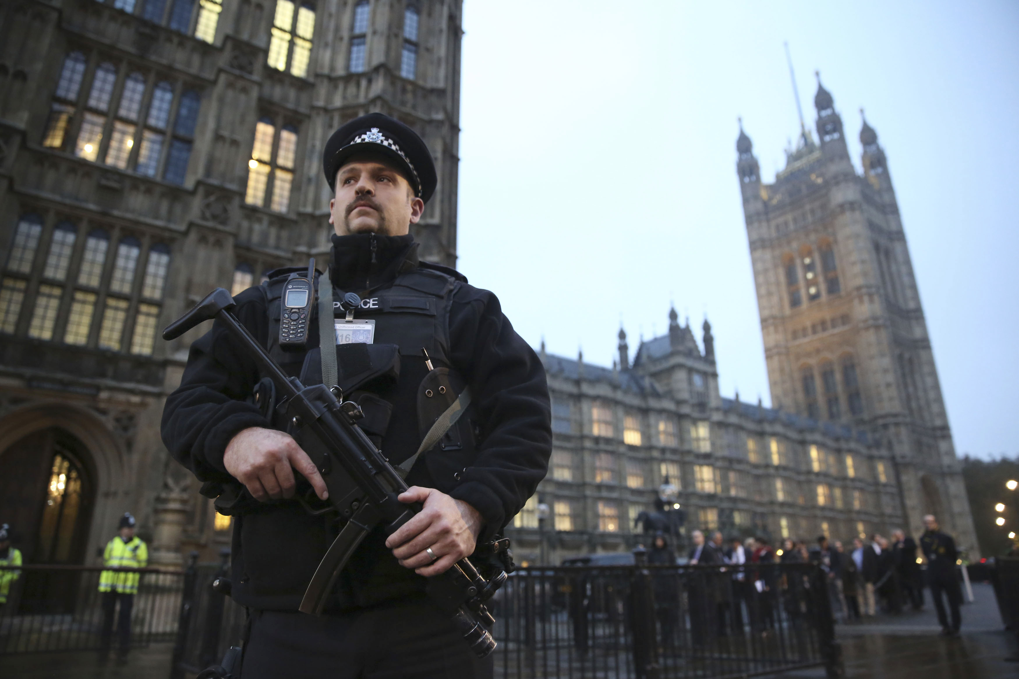 An armed police officer stands outside the Houses of Parliament, central London November 26 , 2014.