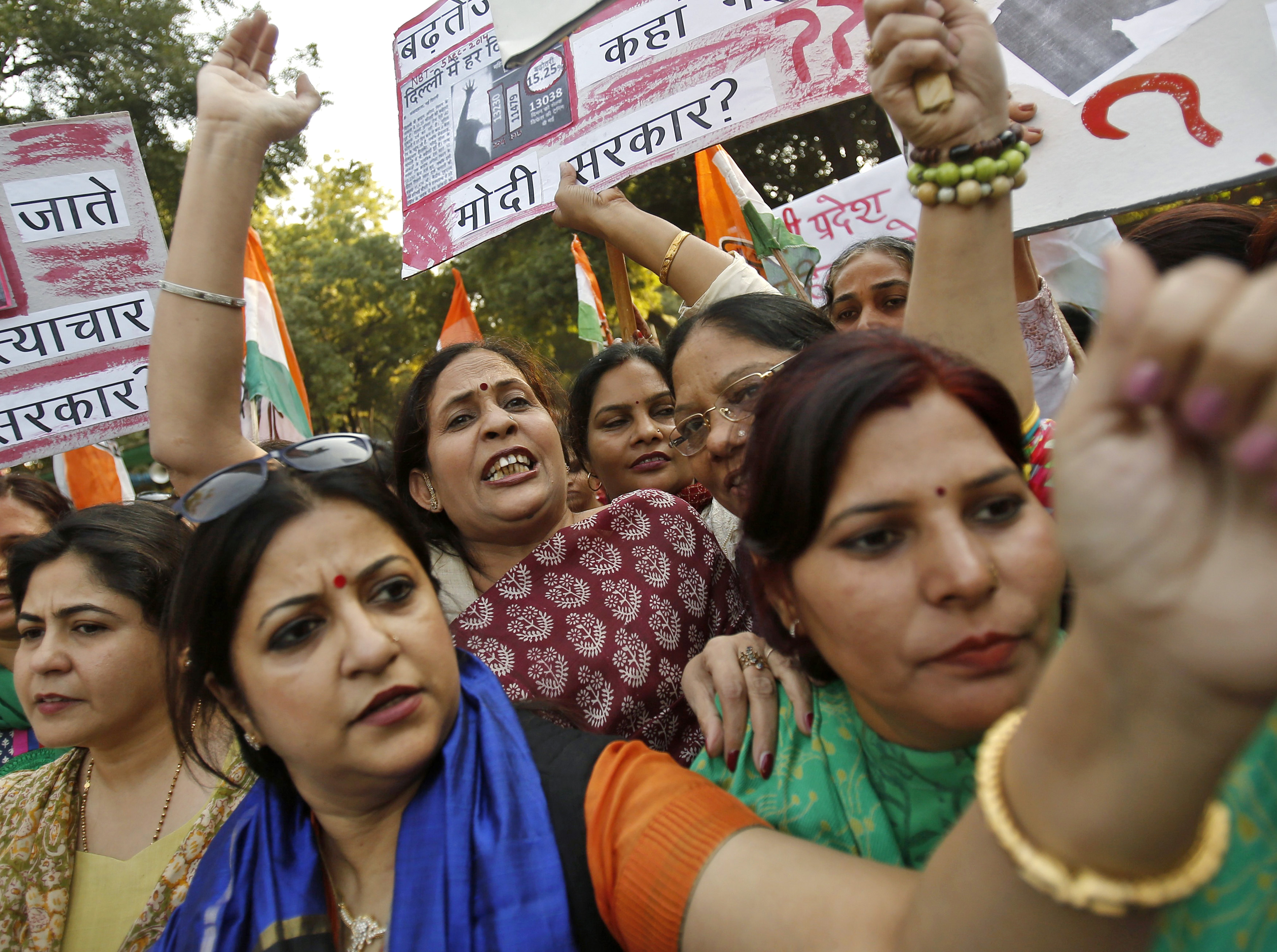 Members of All India Mahila Congress, women's wing of Congress party, shout slogans and carry placards during a protest against the rape of a female Uber passenger in New Delhi on Dec. 8, 2014