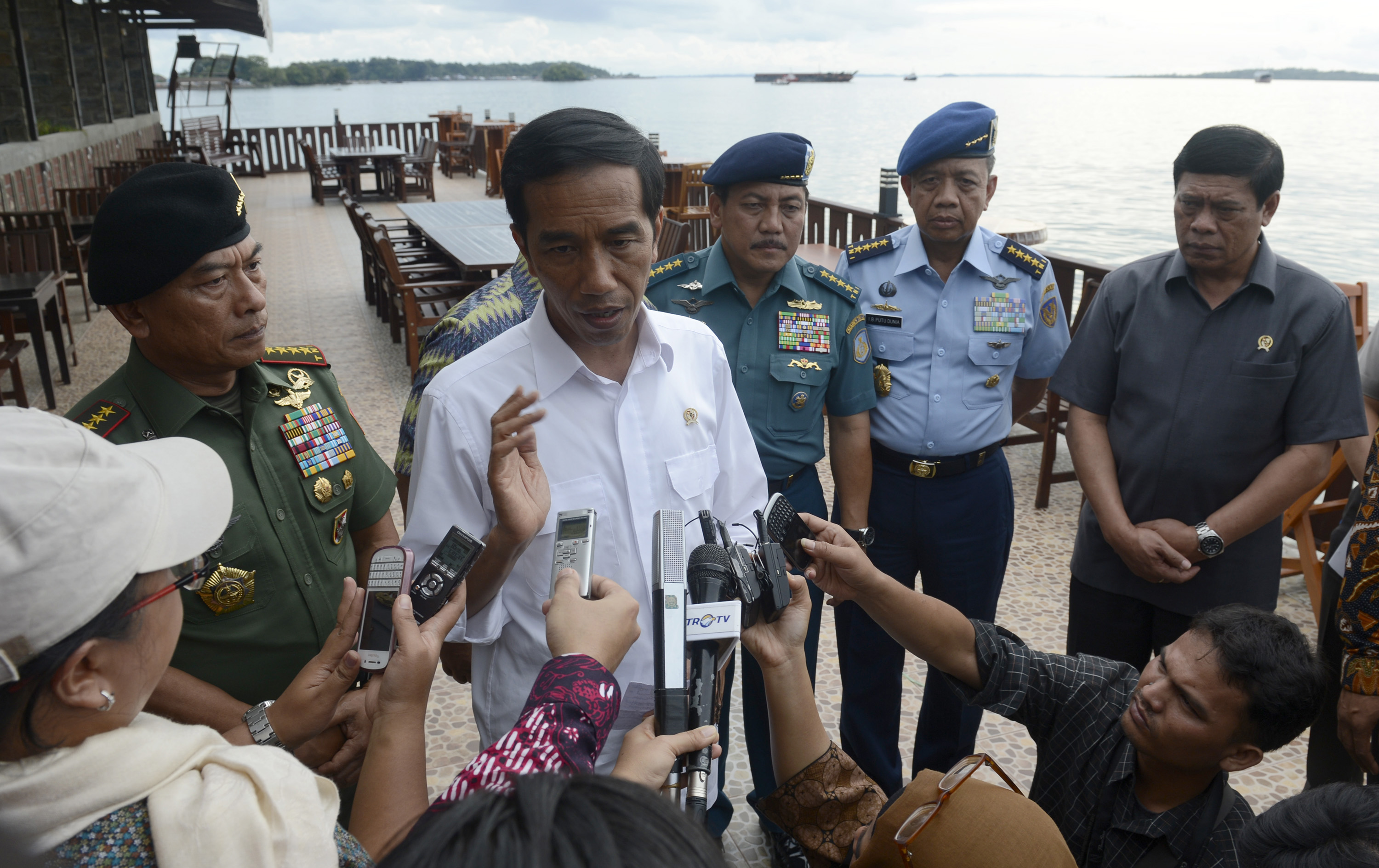 Indonesian President Joko Widodo, center, speaks to the media about AirAsia Flight QZ 8501 in Sorong, West Papua, on Dec. 28, 2014