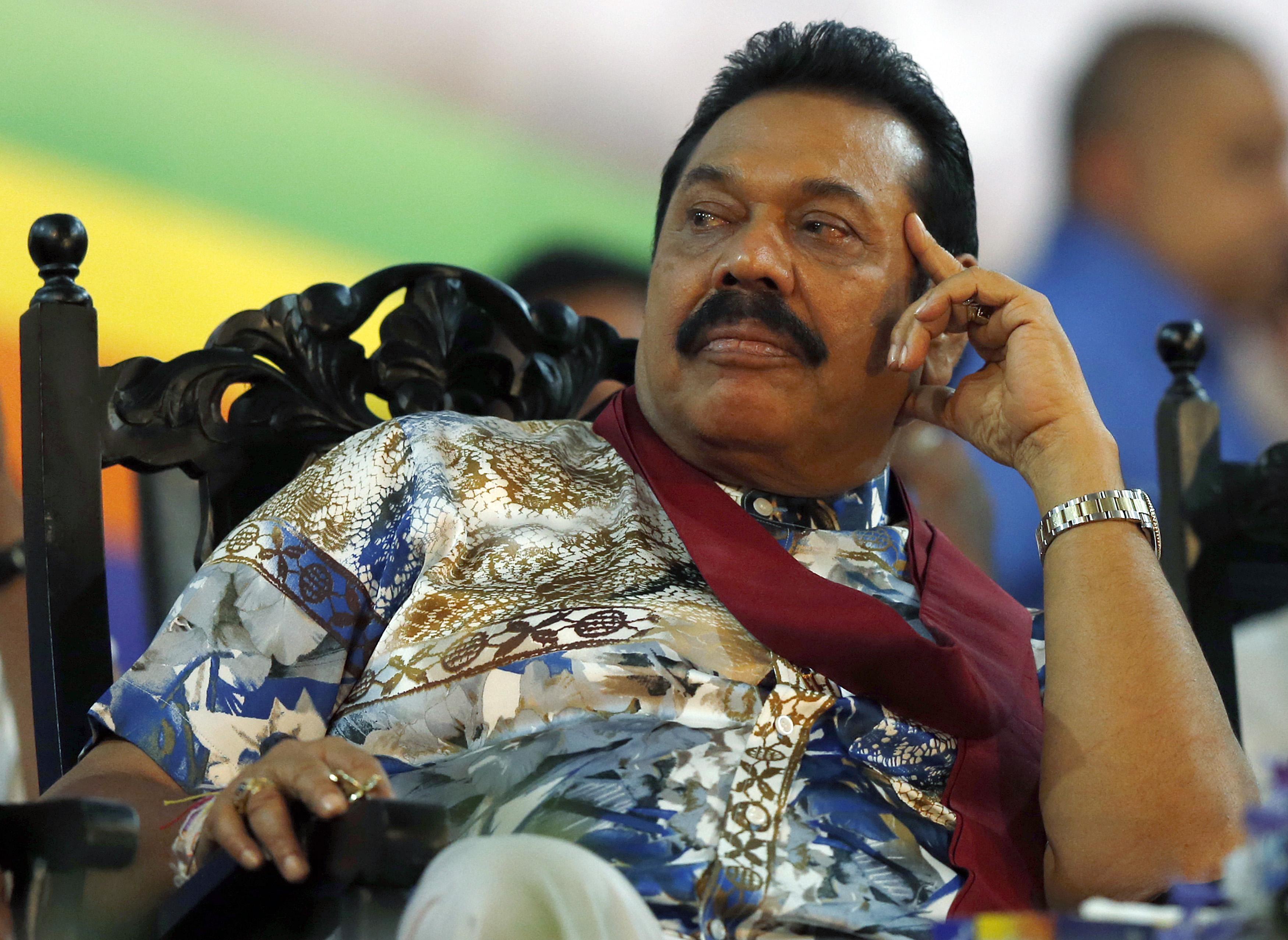 Sri Lankan President Mahinda Rajapaksa listens to a speech during his final rally ahead of the presidential election in Piliyandala, Sri Lanka, on Jan. 5, 2015