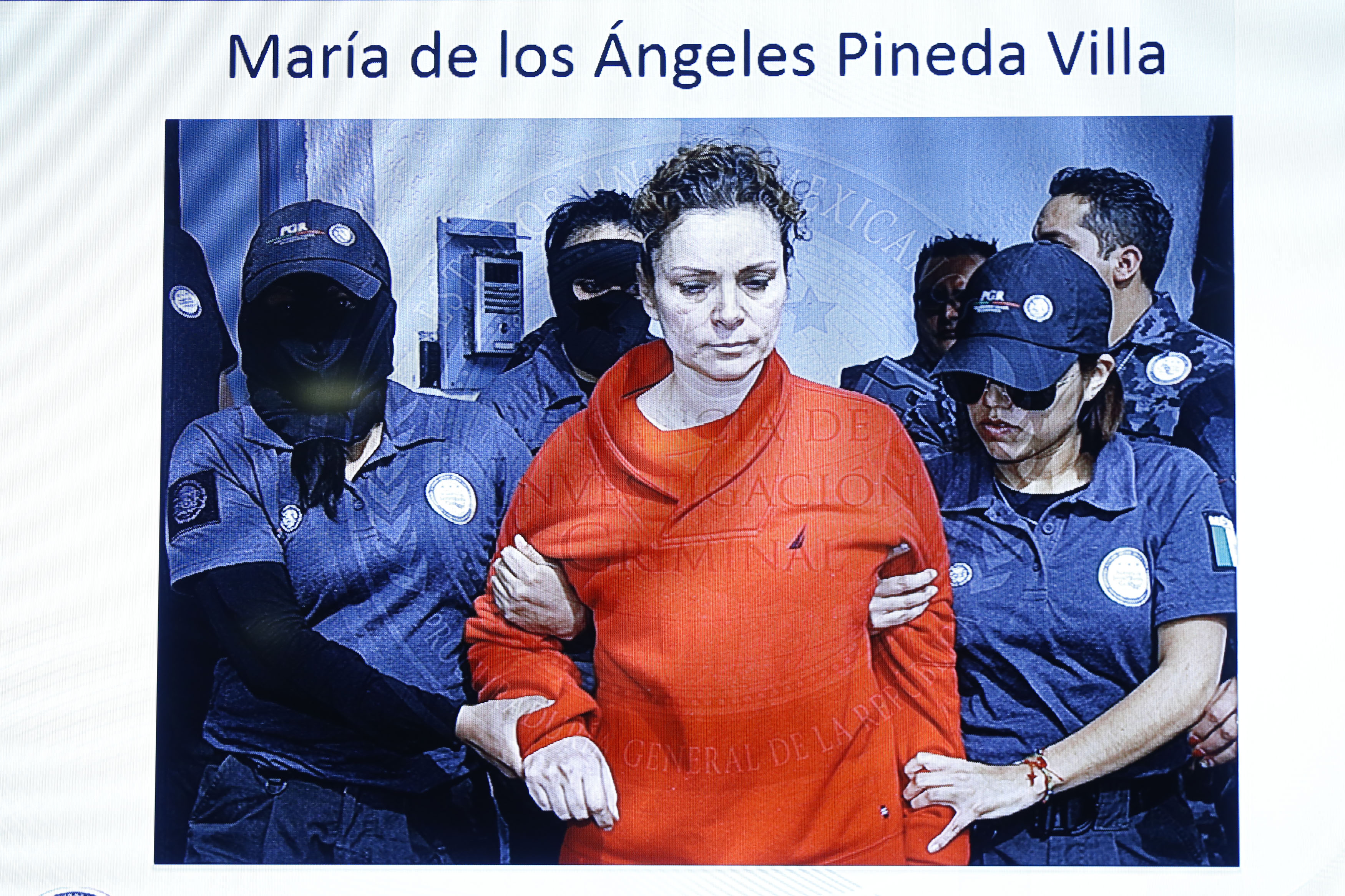 María de los Ángeles Pineda, the wife of former mayor of Iguala, José Luis Abarca, on a television screen while she is transferred to a prison in Tepic, in the Mexican state of Nayarit, in this handout picture released Jan. 5, 2015, by Mexico's Attorney General's Office