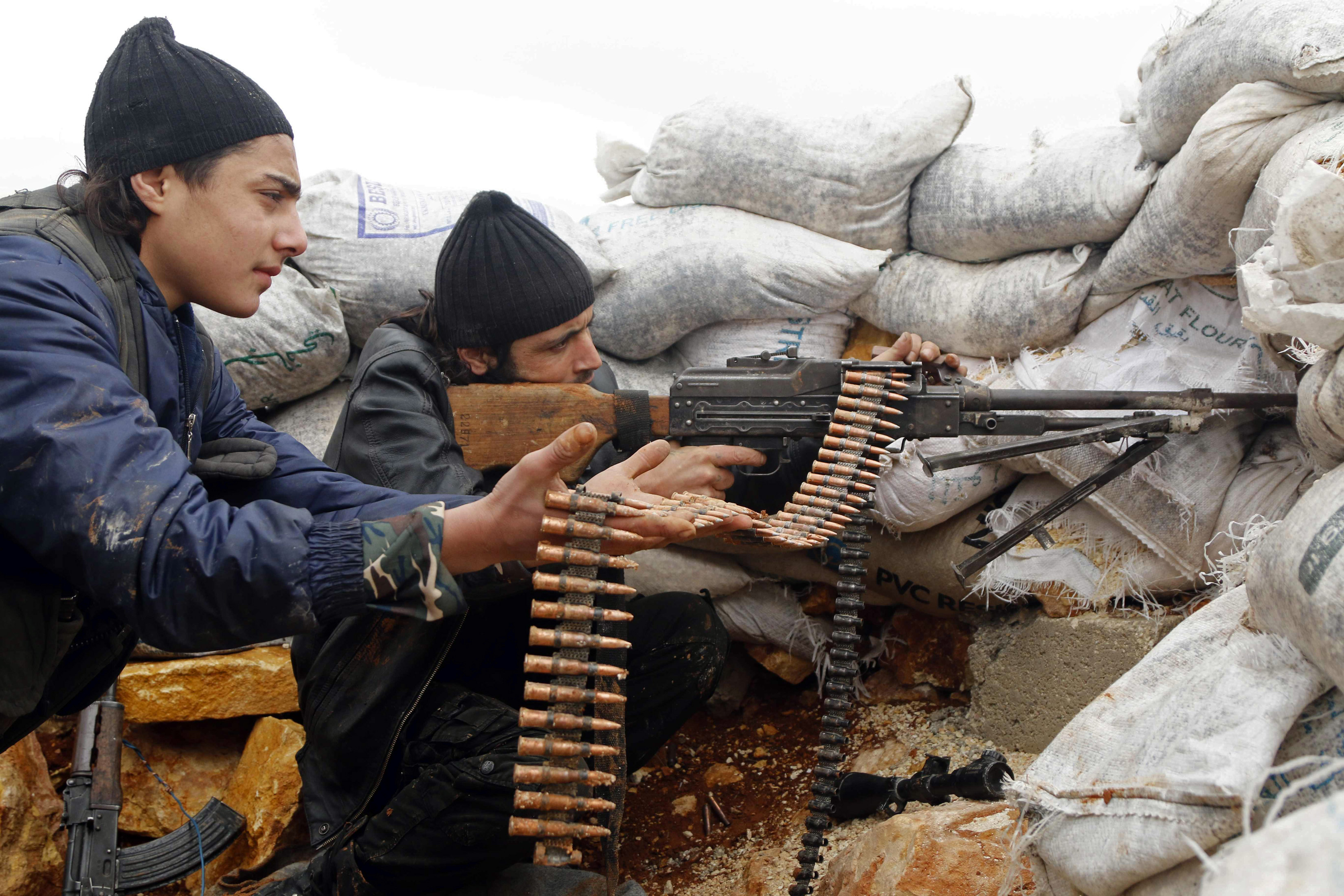 Rebel fighters fire a weapon on the al-Breij frontline, after what they said was an advance by them in the Manasher al-Hajr area where the forces of Syrian President Bashar Assad were stationed in Aleppo, Syria, on Jan. 7, 2015