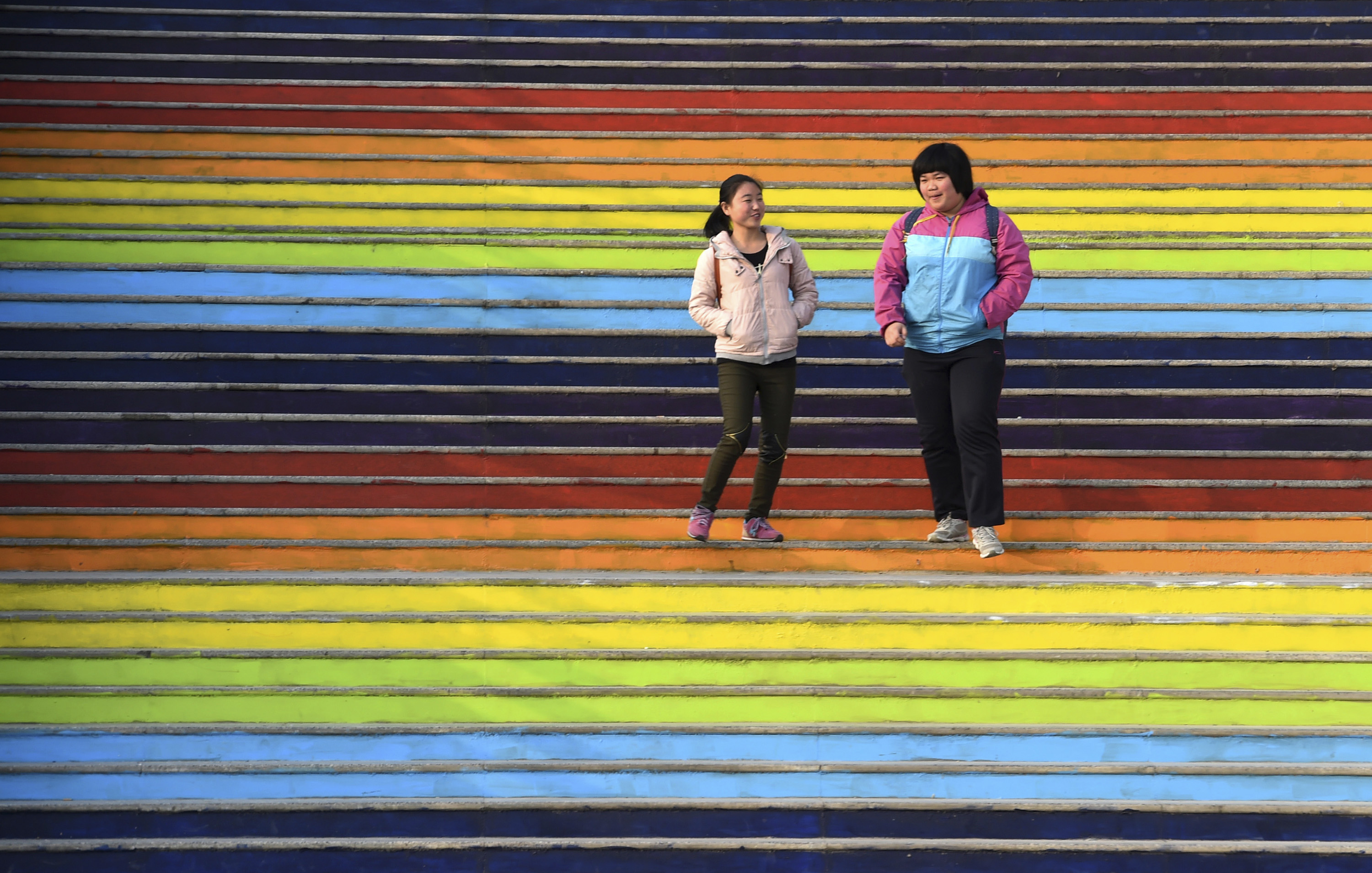 Students walk down a flight of stairs outside a dining hall at the campus of North China University of Water Resources and Electric Power in the Chinese city of Zhengzhou on Jan. 17, 2015