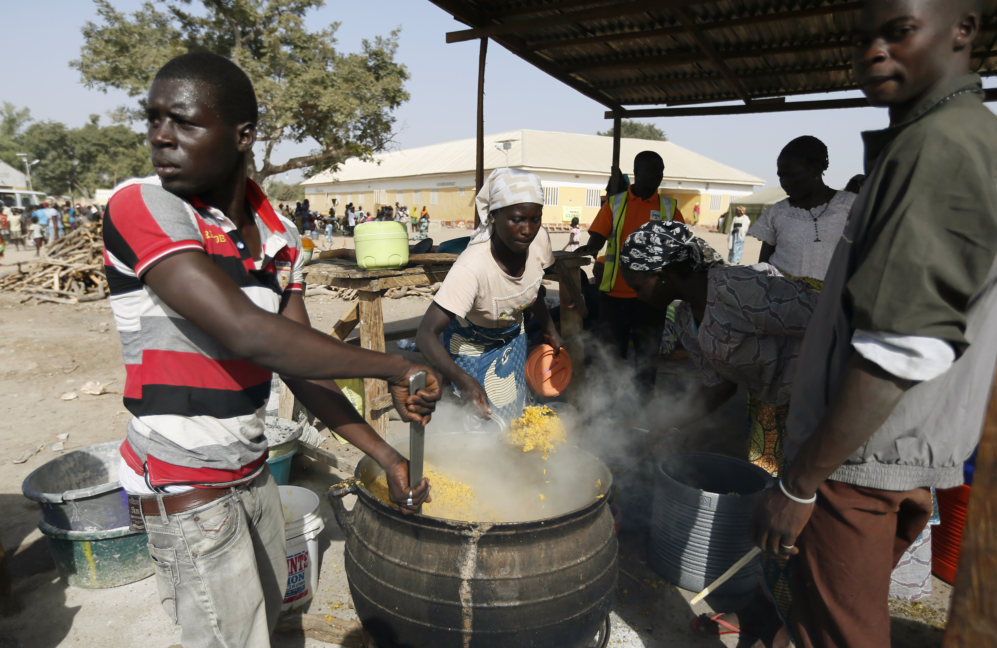 People fleeing Boko Haram violence in the northeast region of Nigeria cook food at Maikohi secondary-school camp for internally displaced persons in Yola, Adamawa State, on Jan. 13, 2015