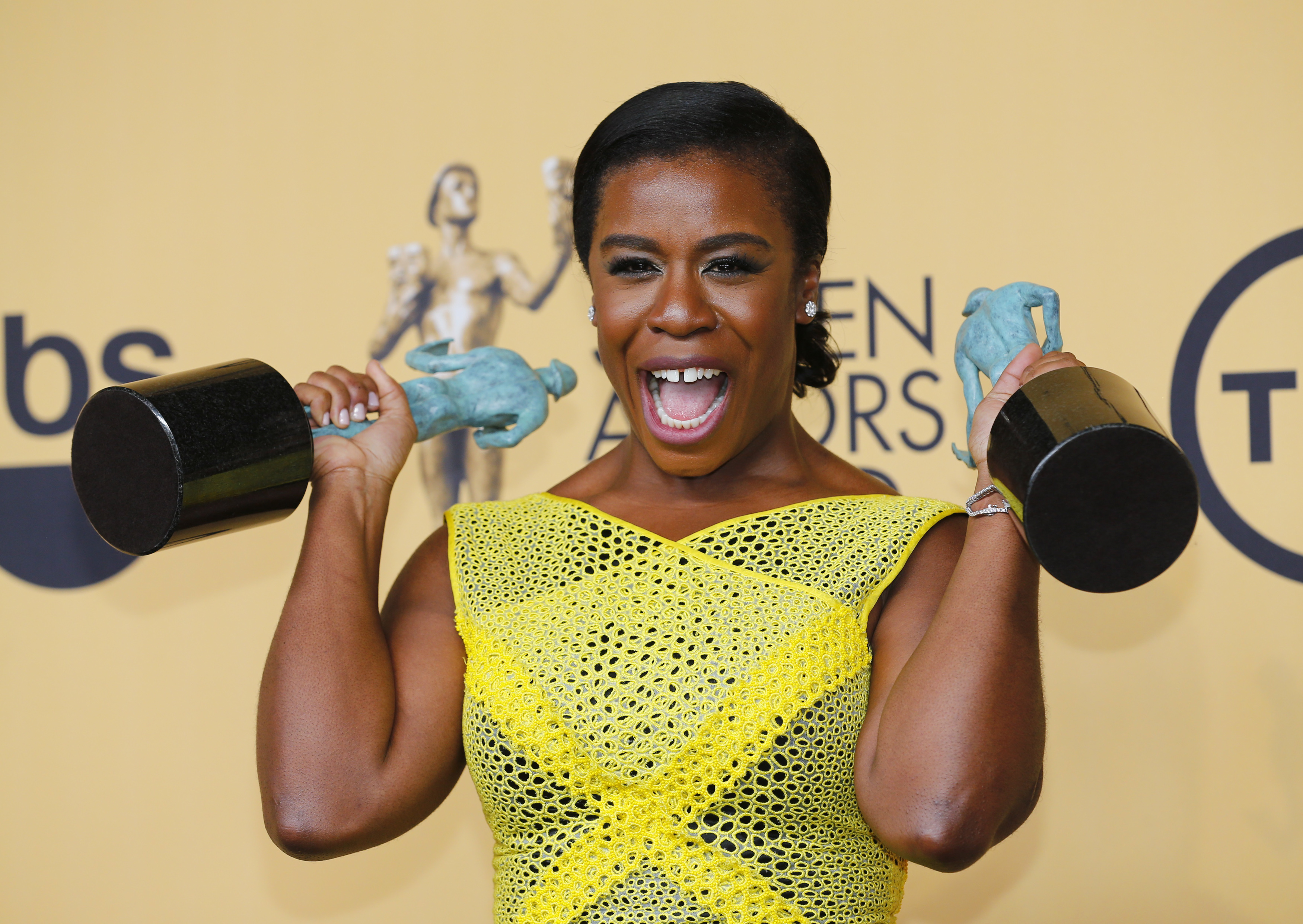 Uzo Aduba of the Netflix series  Orange is the New Black  poses backstage with her awards for Outstanding Performance by an Ensemble in a Comedy Series and Outstanding Performance by a Female Actor in a Comedy Series at the 21st annual Screen Actors Guild Awards in Los Angeles, California Jan. 25, 2015