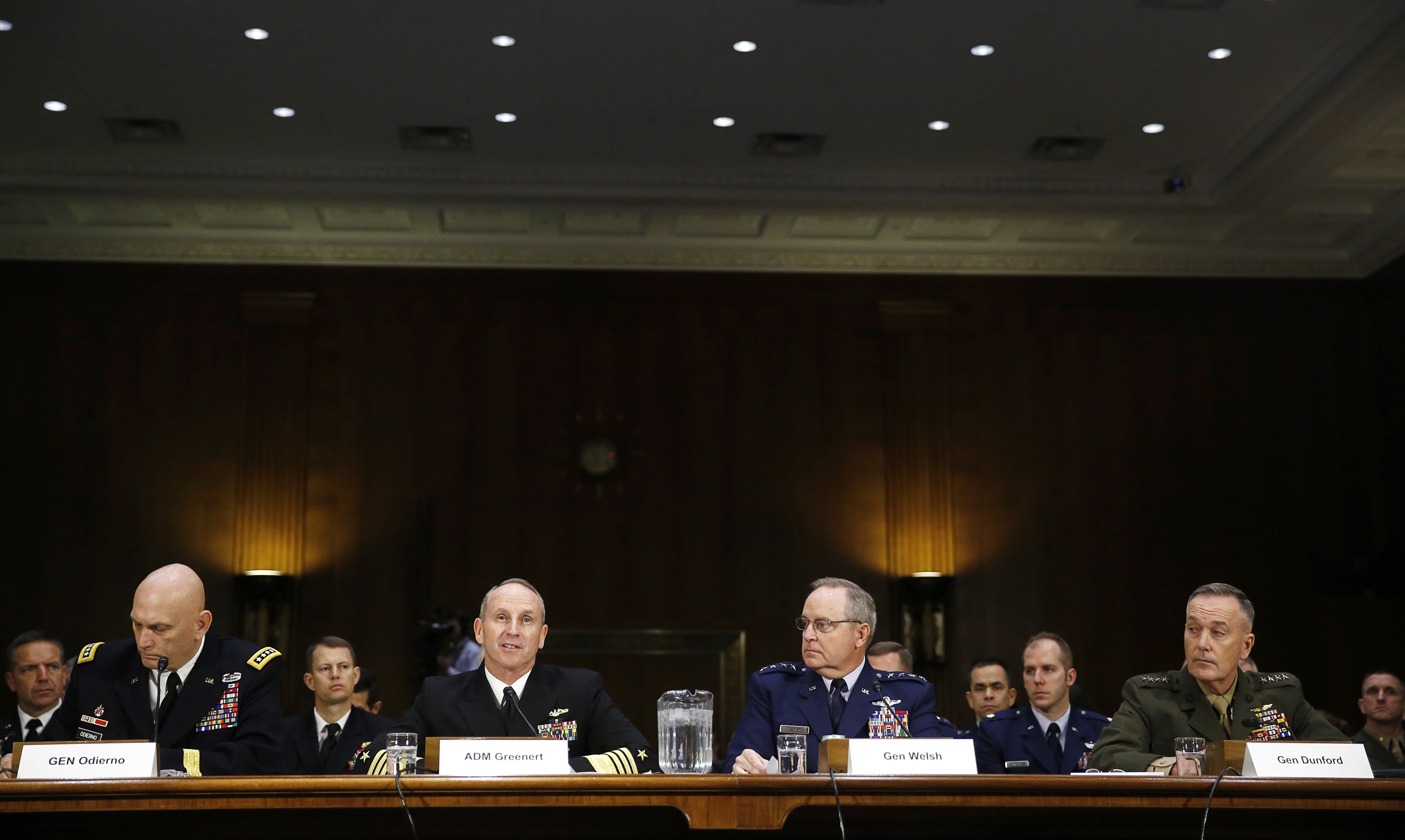 General Raymond Odierno (Army), Admiral Jonathan Greenert (Navy), General Mark Welsh (Air Force), and General Joseph Dunford (Marines) warned a Senate panel Wednesday of the dangers they see if their services' budgets are cut.