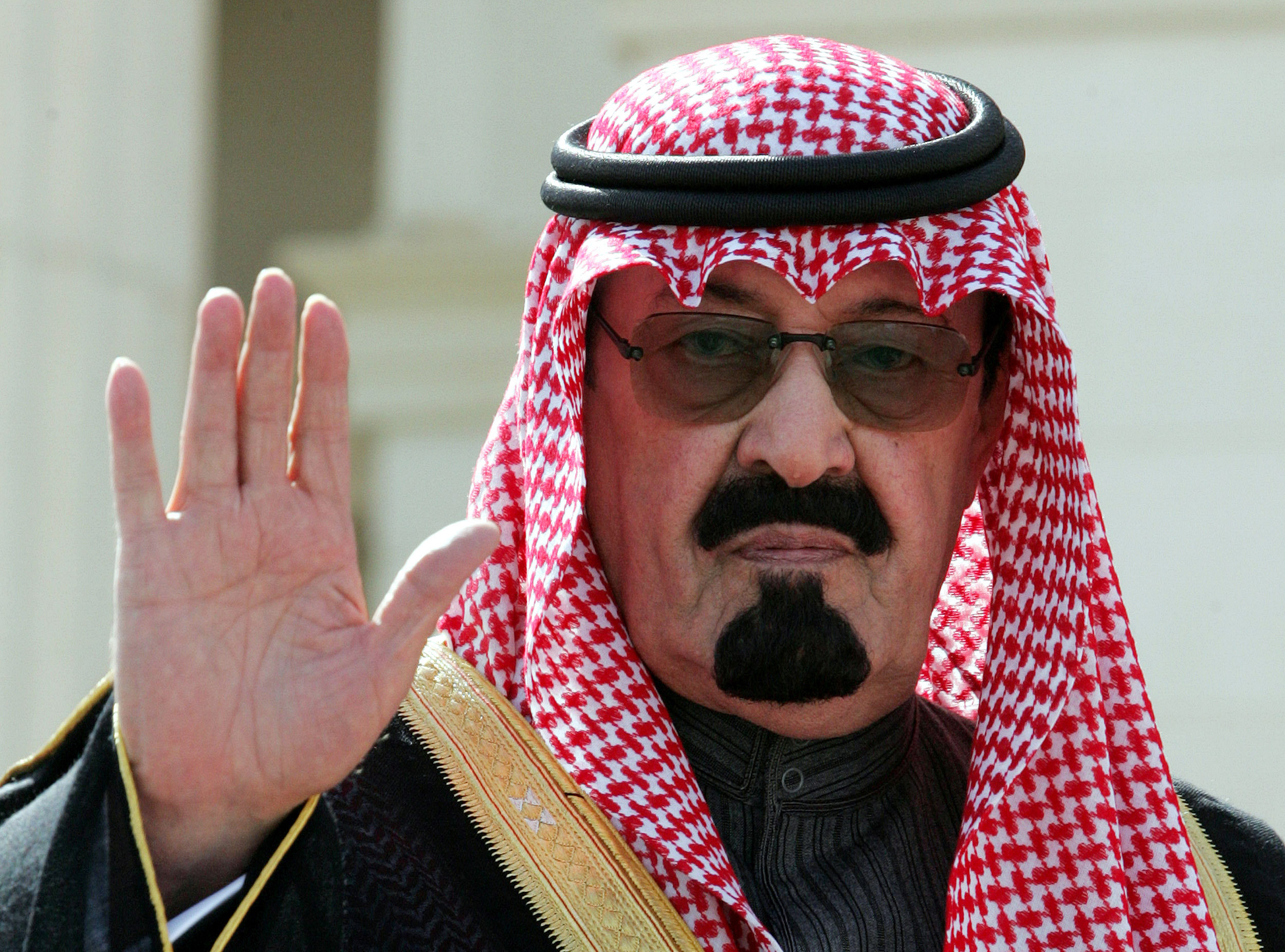 King Abdullah waves as he arrives to open a conference in Riyadh on Feb. 5, 2005