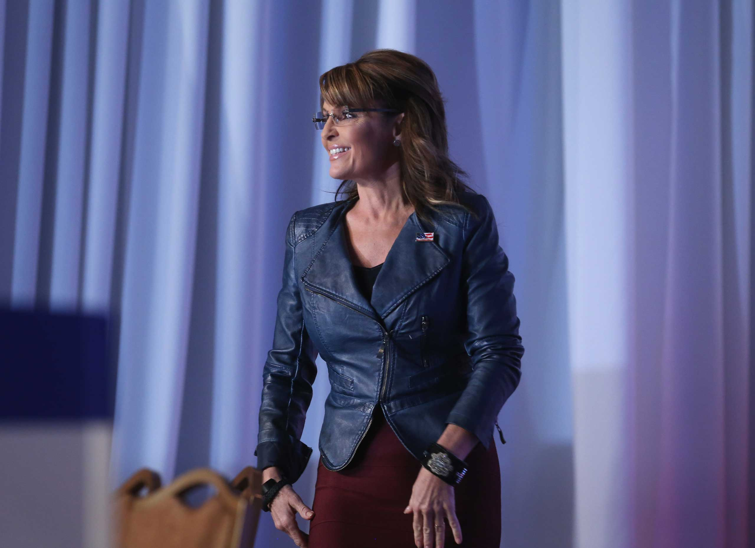 Former Alaska Gov. Sarah Palin (R) walks onstage to speak at the 2014 Values Voter Summit in Washington on Sept. 26, 2014.