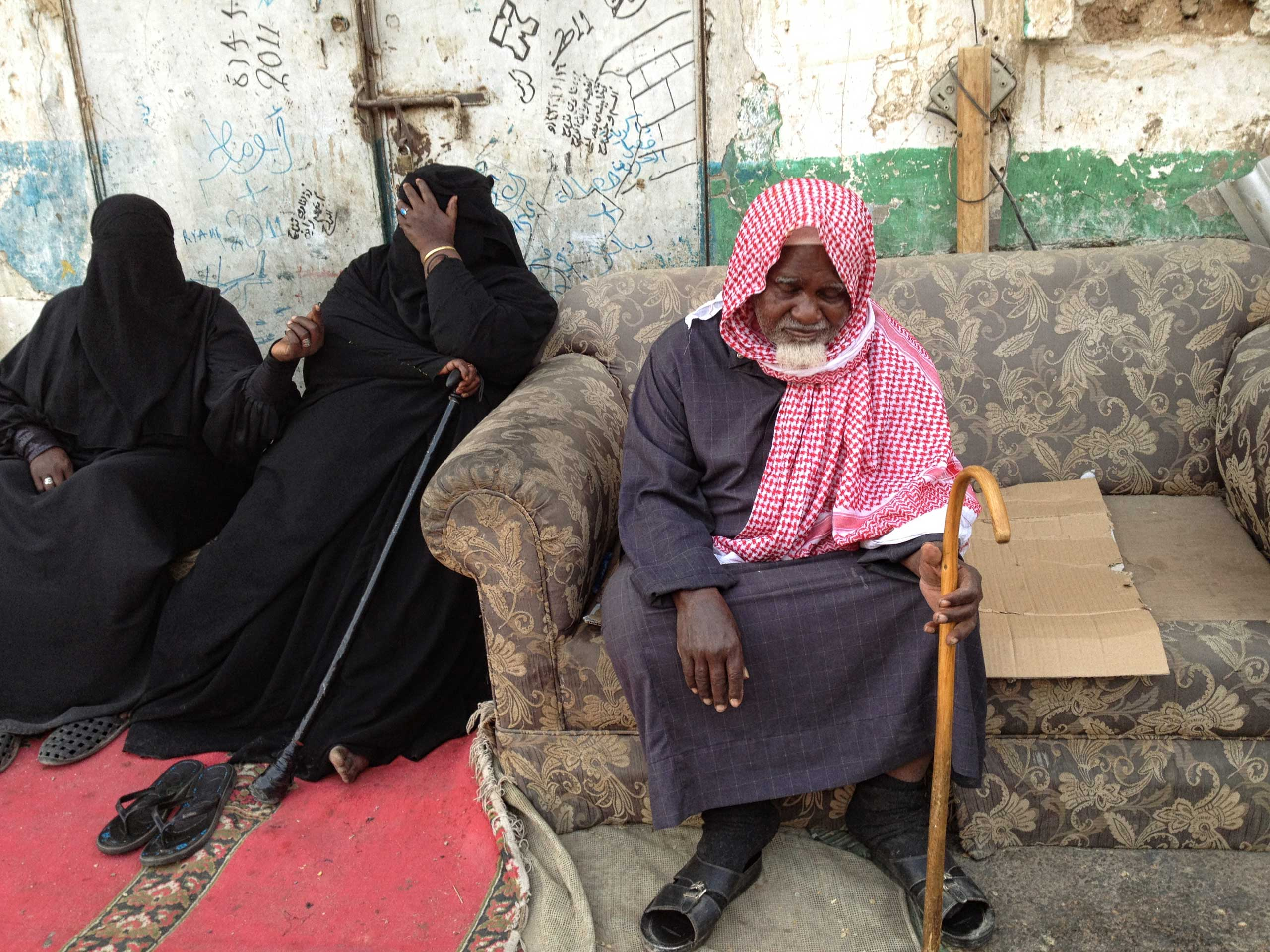 Saudis beg in a line on a street known to locals as 'The Beggars' Street,' in South Riyadh.