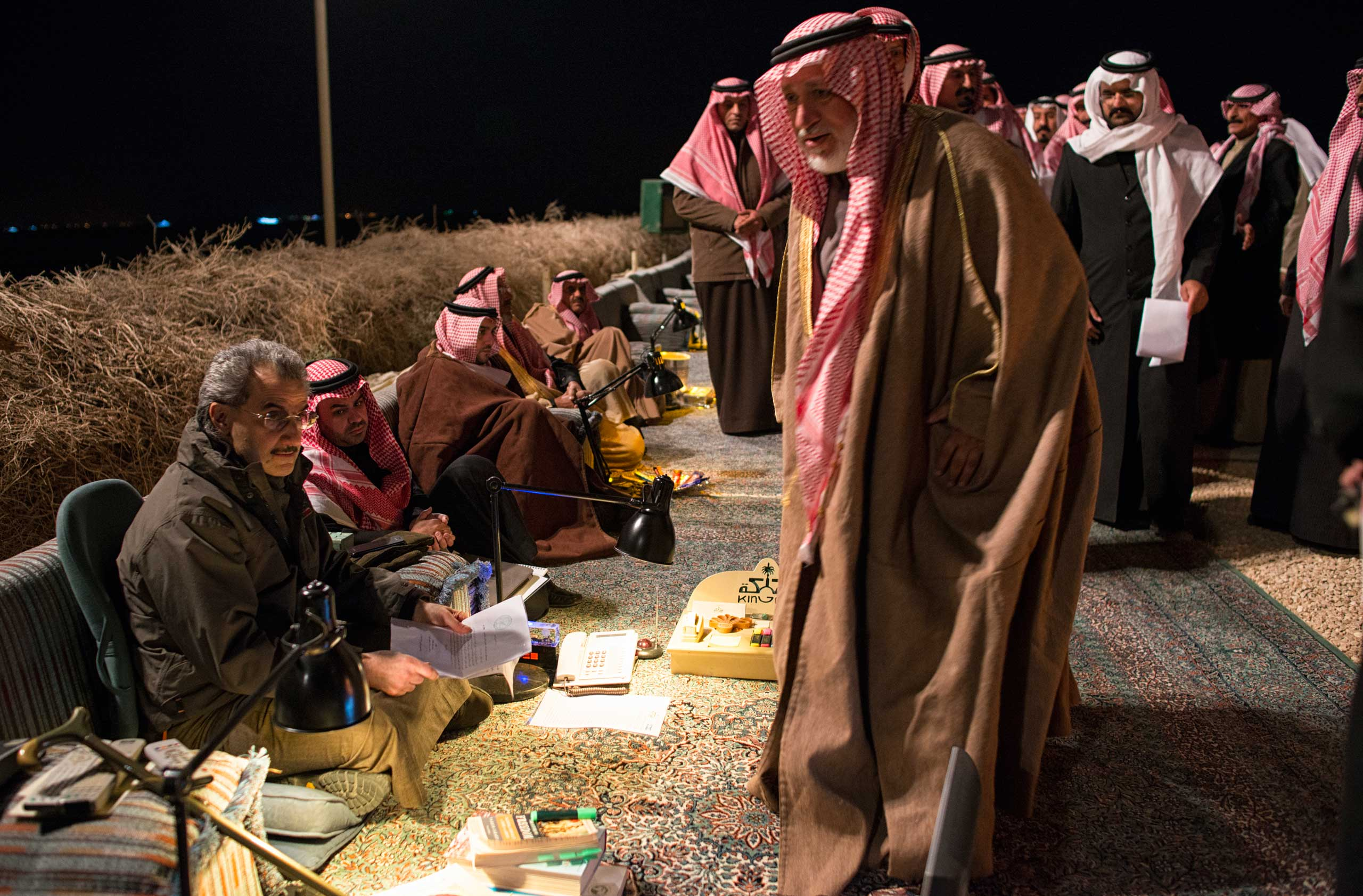 Saudi billionaire, HRH Prince Waleed bin Talal, greets Saudi citizens at a desert camp outside of Riyadh to accept their petitions for his help.