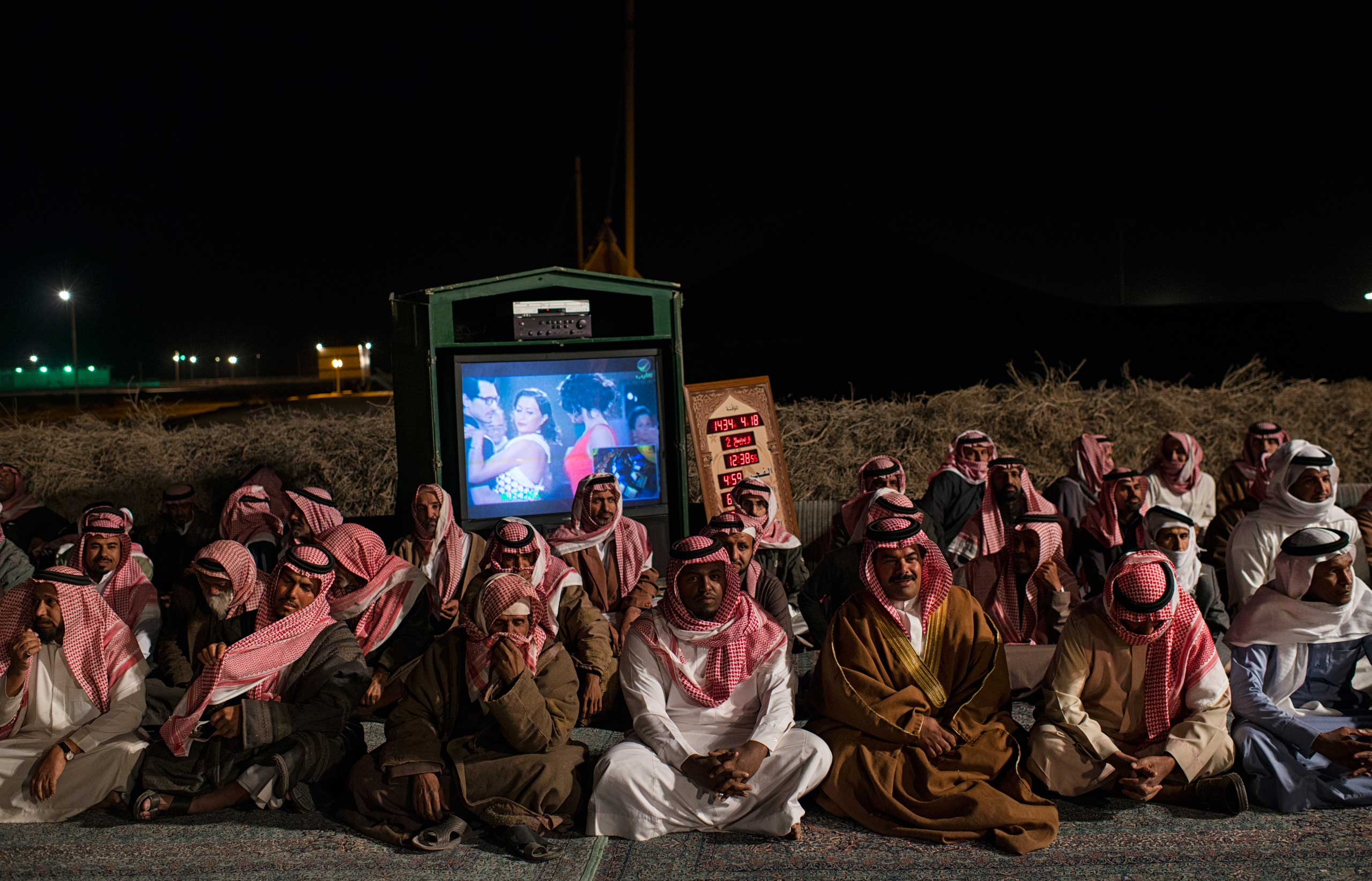 Saudi citizens rest after presenting Saudi billionaire, HRH Prince al Waleed bin Talal, with petitions for his help at a desert camp outside of Riyadh.