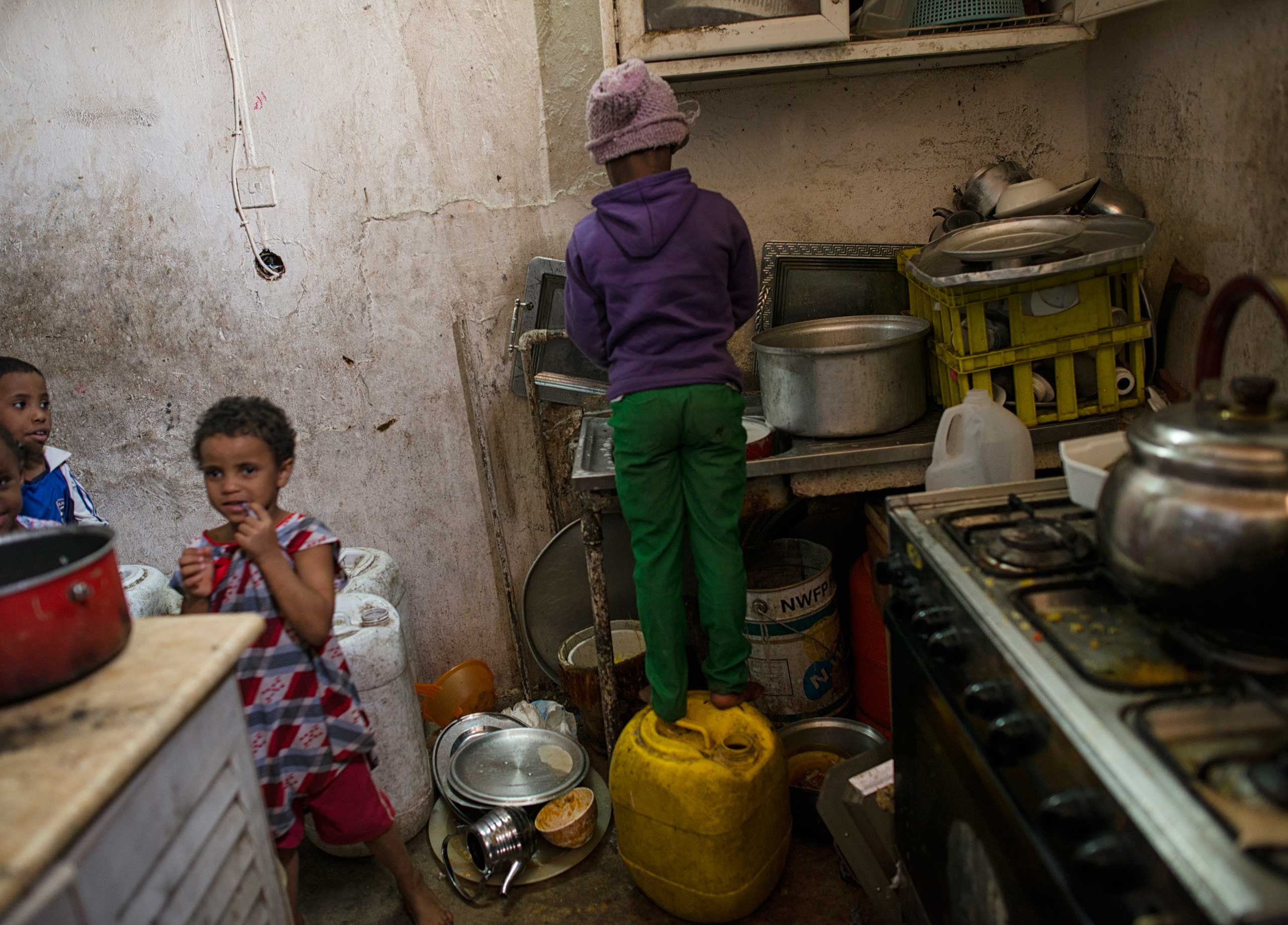 Saudi children do the dishes in a home in South Riyadh.