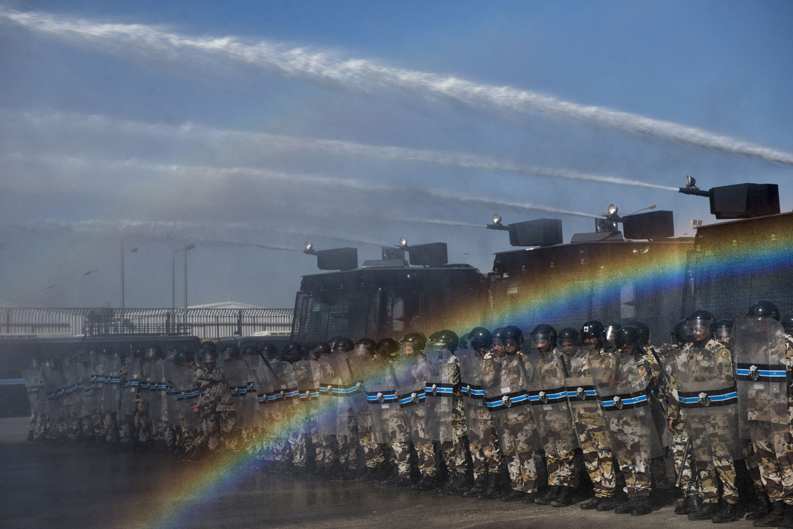 Troops with the Saudi Special Security Forces simulate how they would break up a demonstration with water cannons and protective gear, March 5, 2013.