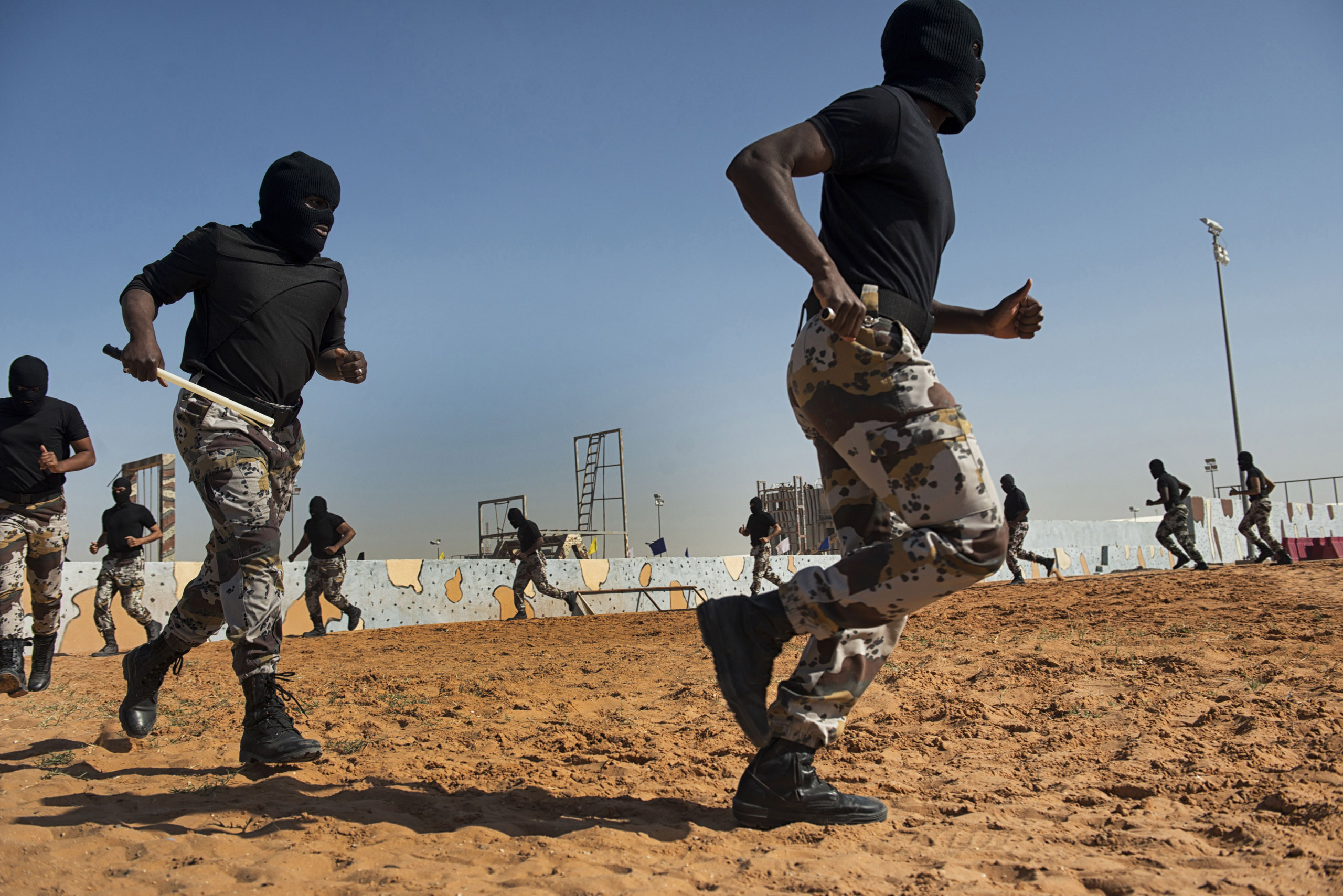 Troops with the Saudi Special Security Forces warm up and perform basic exercises to increase strength and agility at the Counter-Terrorism Training School camp, March 5, 2013.
