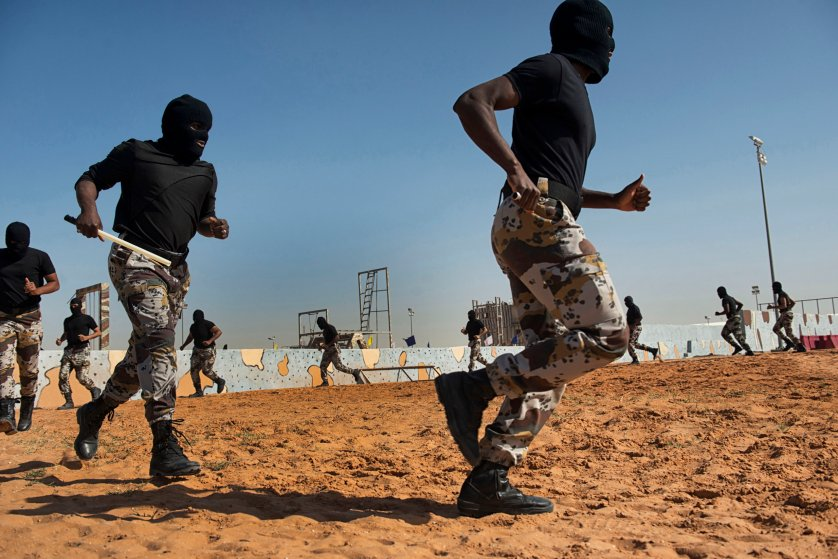 Troops with the Saudi Special Security Forces warm up and perform basic exercizes to increase strength and agility at the Counter-Terrorism Training School camp under the Ministry of Interior in Riyadh, Saudi Arabia, March 5, 2013.  The Saudi government has been fighting terrorism within the Kingdom for decades, and has roughly 3,000 SEF in Riyadh, alone.  Despite a fraugh relationship with the United States in the past, Saudi Arabia and the U.S. have routinely shared security information in order to prevent and fight terrorism.  With the recent death of HRH King Abdullah, the international community is looking to the newly appointed HRH King Salman to see how he develop the Kingdom's relationship with the West.  (Credit: Lynsey Addario/ Getty Reportage)