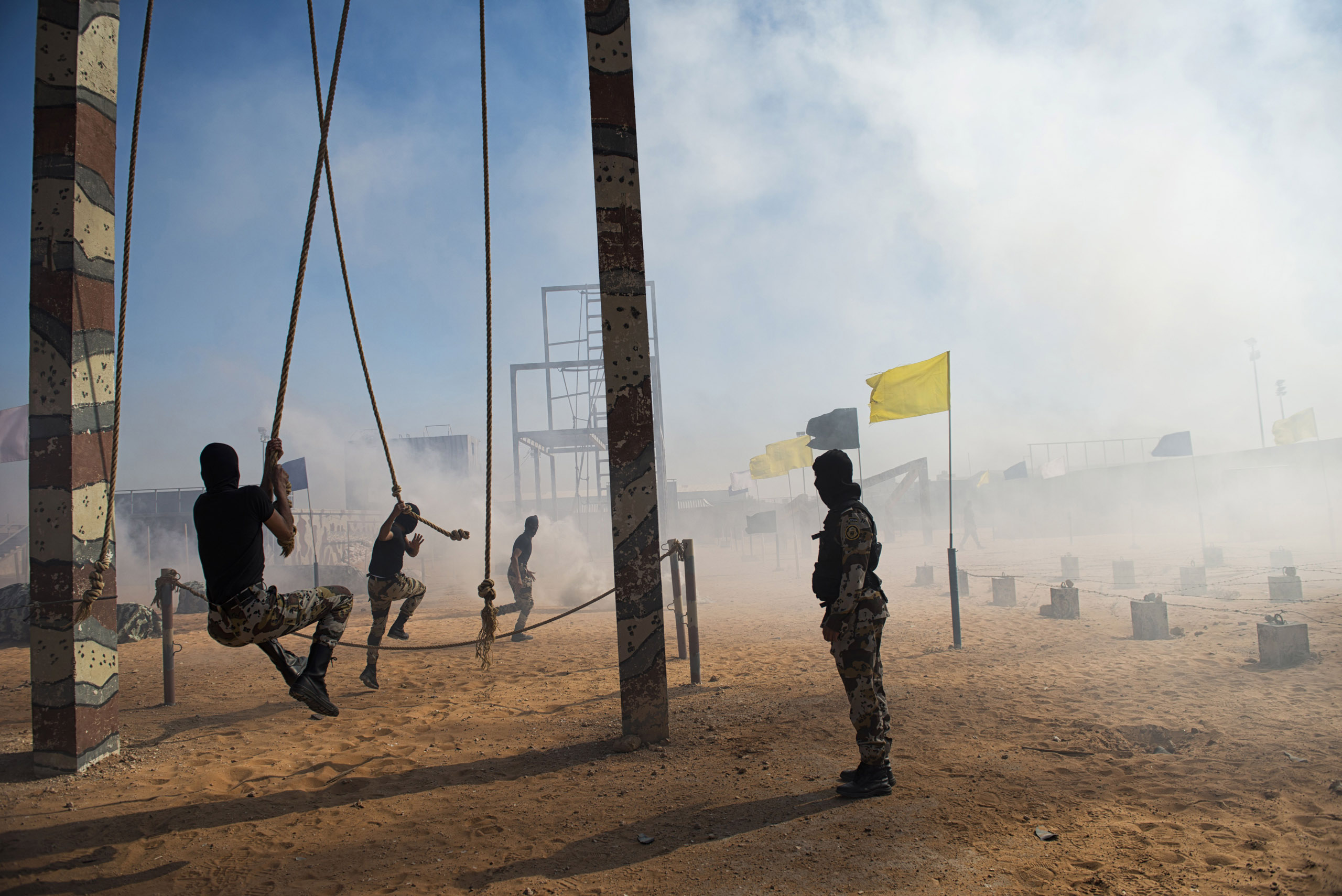 Troops with the Saudi Special Security Forces repel into a recreated scene of an explosion and ongoing attack, March 5, 2013.
