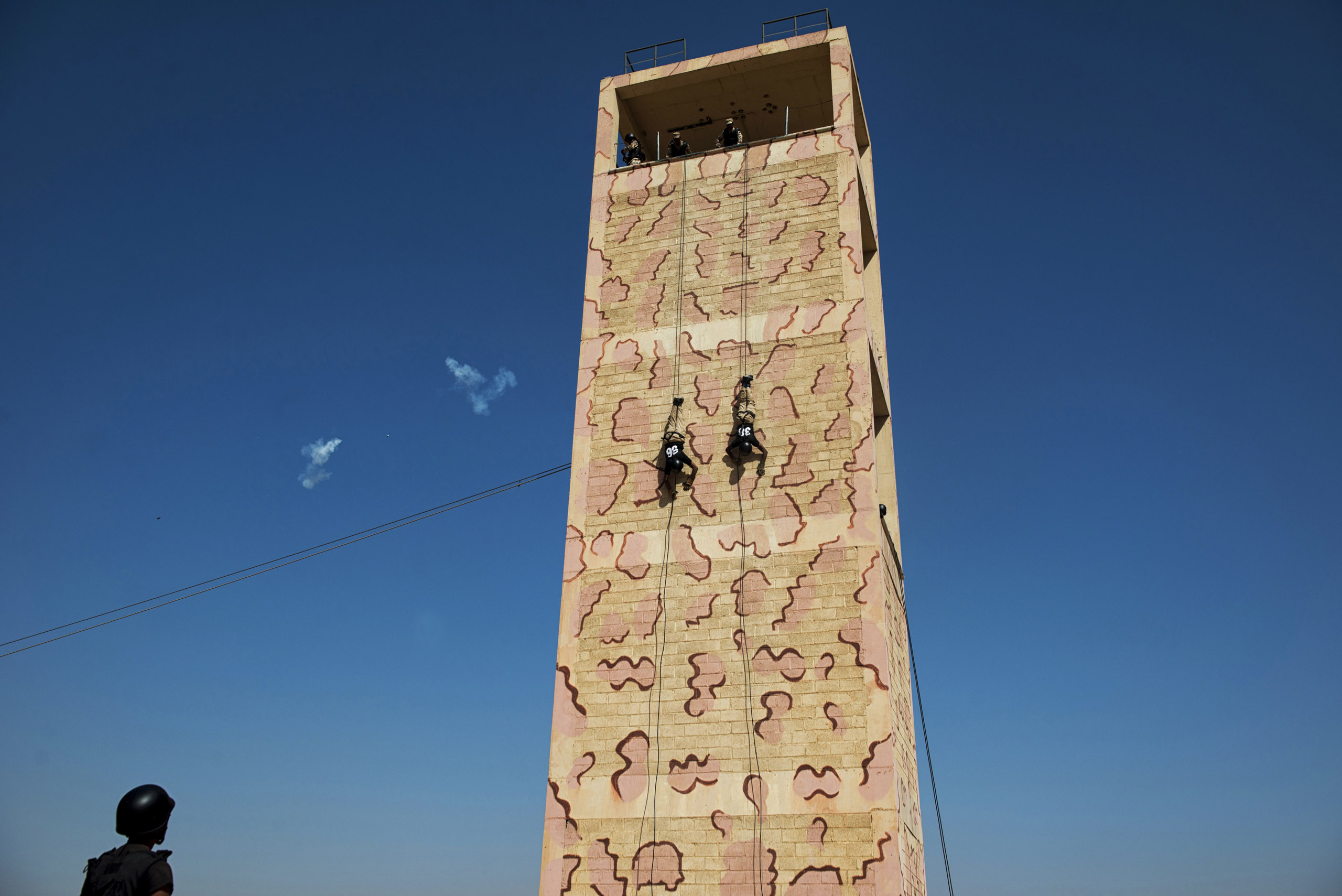 Troops with the Saudi Special Security Forces repel down a building during a simulated terrorist attack, March 5, 2013.