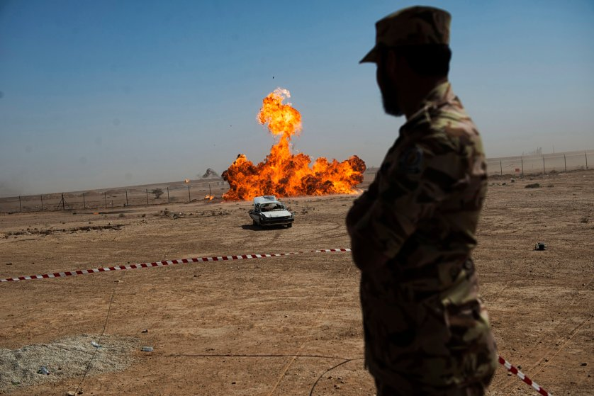A troop with the Saudi Special Security Forces watches a remote detonation at the Counter-Terrorism Training School camp under the Ministry of Interior in Riyadh, Saudi Arabia, March 5, 2013.  The Saudi government has been fighting terrorism within the Kingdom for decades, and has roughly 3,000 SEF in Riyadh, alone.  Despite a fraugh relationship with the United States in the past, Saudi Arabia and the U.S. have routinely shared security information in order to prevent and fight terrorism.   (Credit: Lynsey Addario/ Getty Reportage)