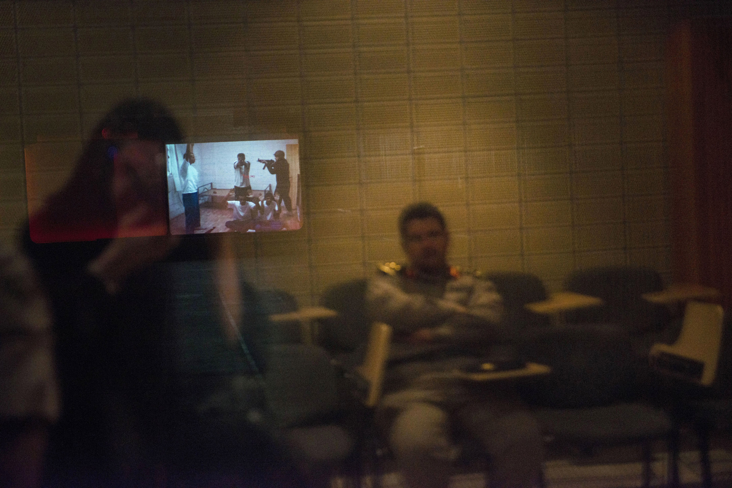A video of a simulated  raid on a group of terrorists is shown in a room at the Counter-Terrorism Training School camp, March 5, 2013.